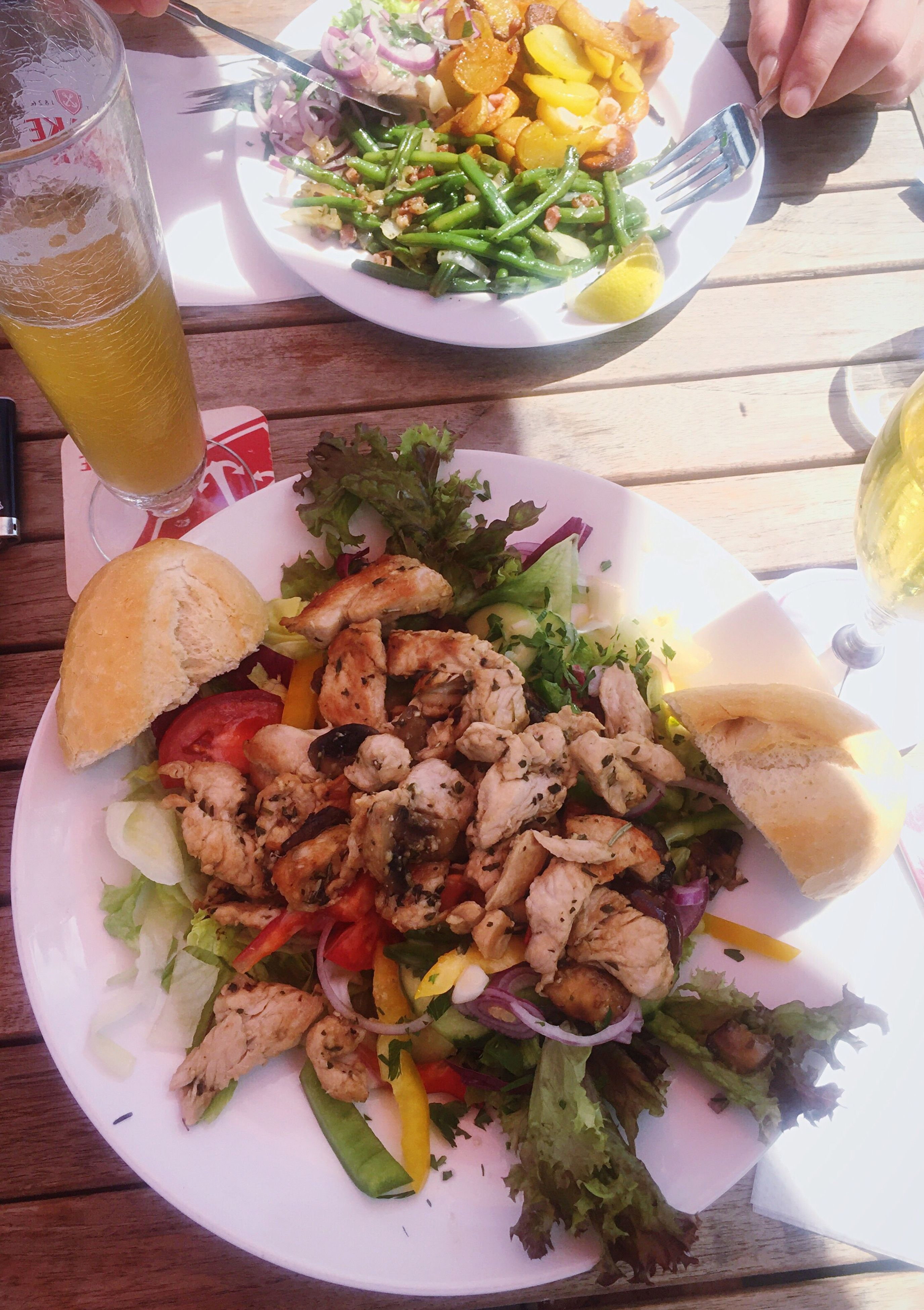 food and drink, table, freshness, food, plate, ready-to-eat, serving size, drink, human hand, healthy eating, indoors, salad, high angle view, drinking glass, alcohol, human body part, close-up, day, one person, people