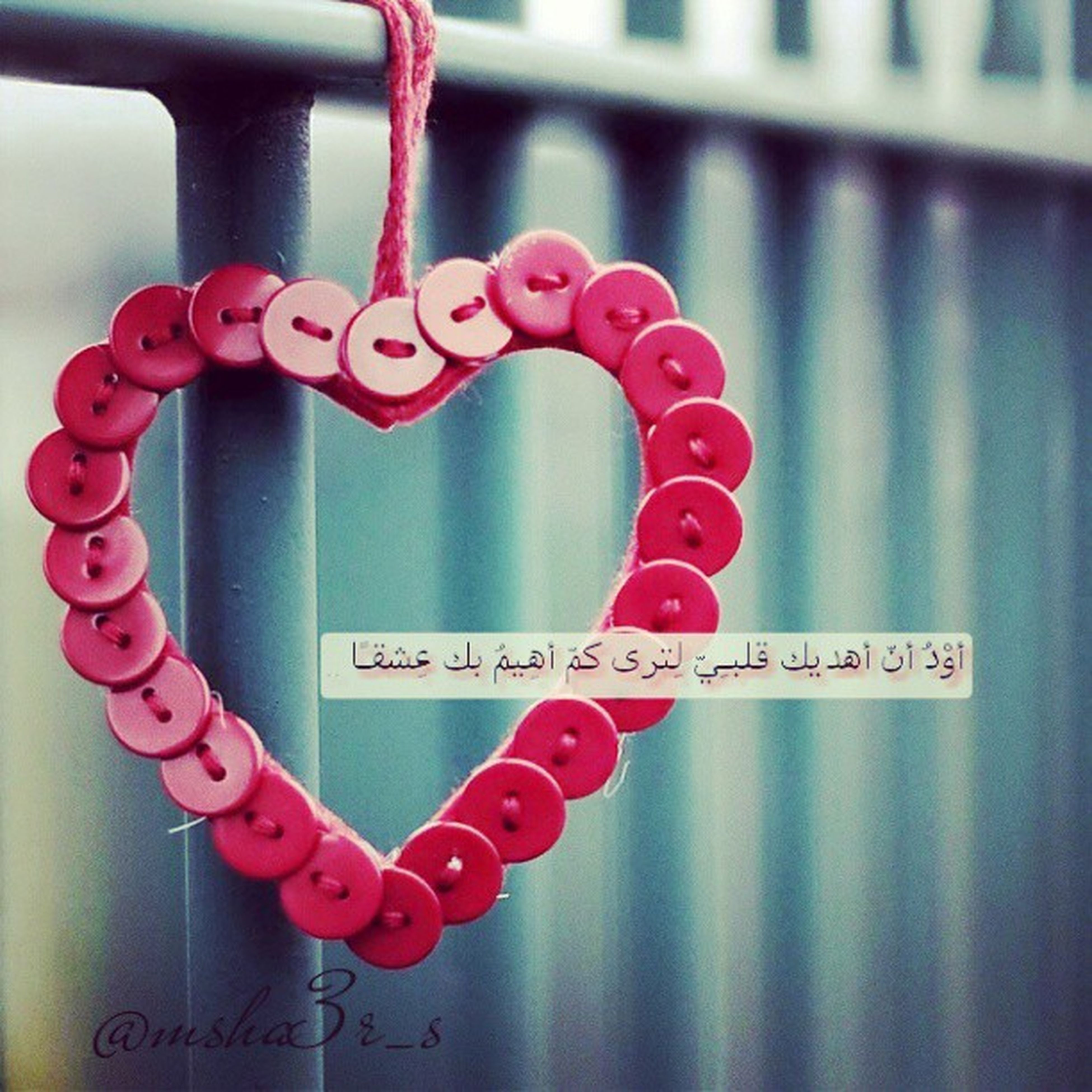text, western script, communication, red, indoors, close-up, non-western script, focus on foreground, heart shape, capital letter, hanging, metal, sign, no people, information sign, love, wall - building feature, pink color, message, information