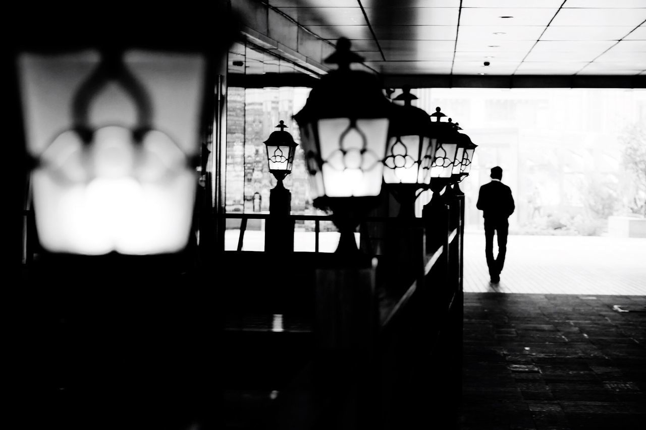EyeEmNewHere Black And White Waiting Lighting Equipment Lights Atmosphere Atmospheric Mood Feelings Time One Person Man Looking Forward Piano Moments