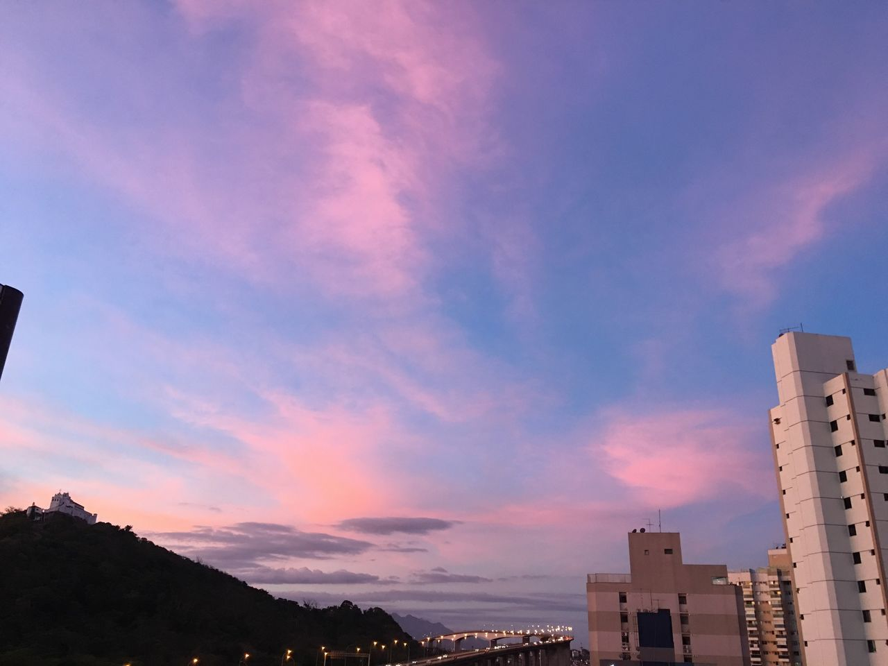 architecture, building exterior, built structure, sky, cloud - sky, sunset, city, low angle view, no people, outdoors, nature, skyscraper, cityscape, day