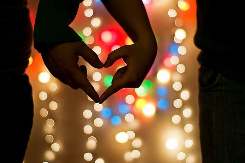 Togetherness Celebration Illuminated Defocused Young Adult Indoors  People Night Human Body Part Human Hand Christmas Lights Young Women Adult Adults Only Two People Party - Social Event Only Women Multi Colored Bonding Close-up