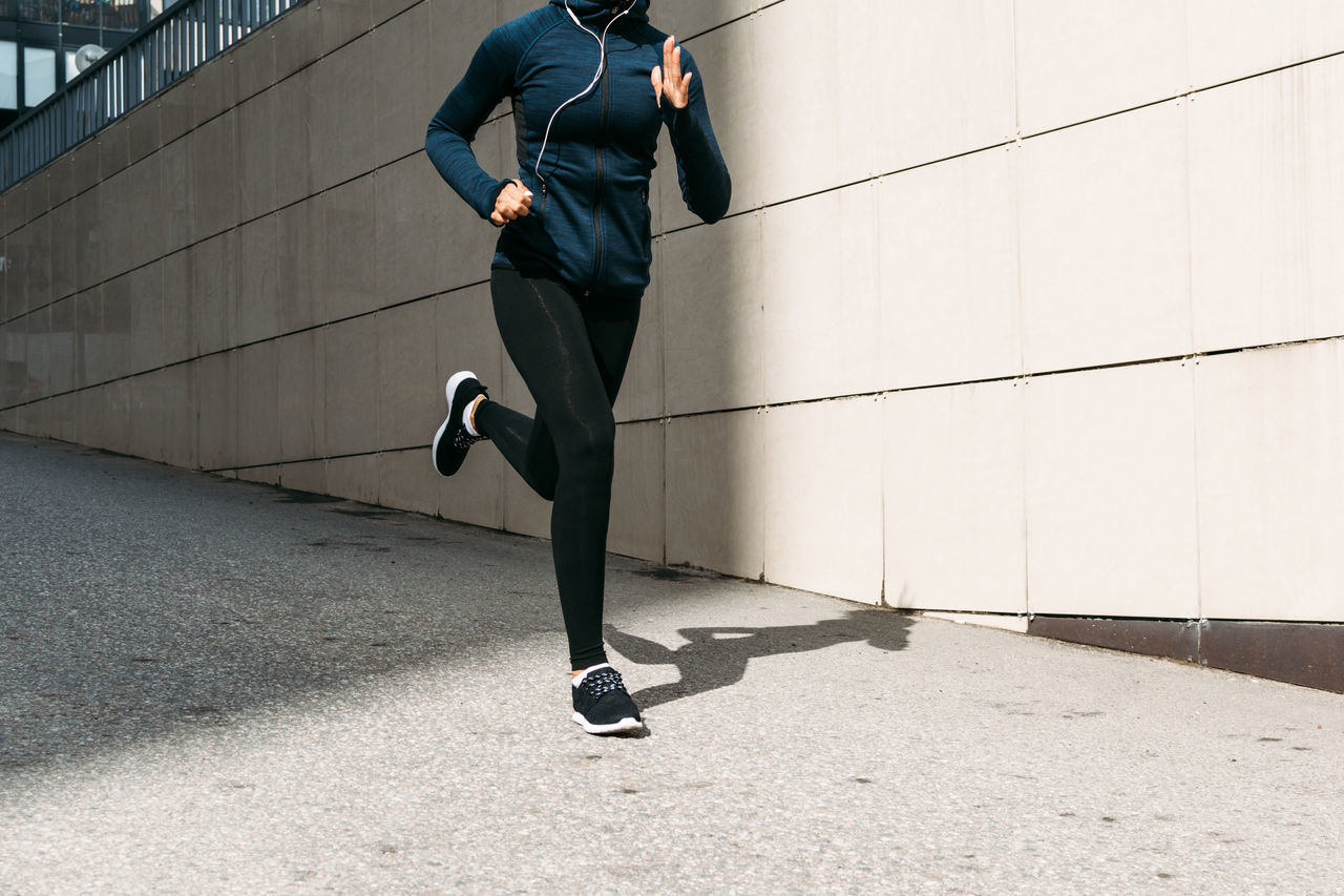 Day Exercising Female Full Length Healthy Lifestyle Jogging Lifestyles Low Section Motion One Person Outdoors People Person Real People Running Sport Sports Clothing Sportsman Unrecognisable Unrecognizable Woman Young Adult