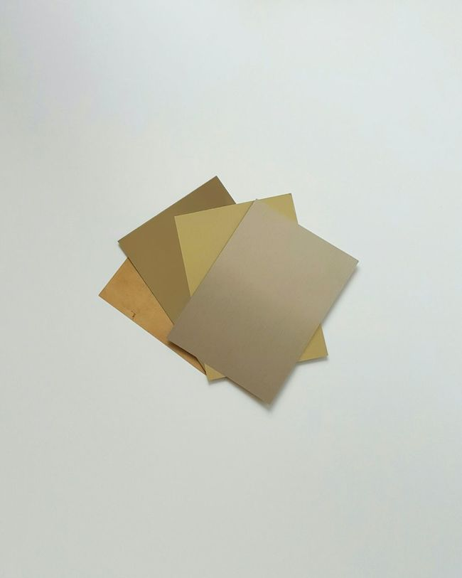 Different shades of gold Different Shades Of Gold Putting Together Color Palette Gold Art Shade Being Creative Puzzle  43 Golden Moments Arranging Golden Lying On The Floor EyeEm Best Shots Minimalism Art Work Artphotography No People White Background Choice Interior Design Forms Warm Colors Your Design Story Pattern Pieces Shades Of Gold