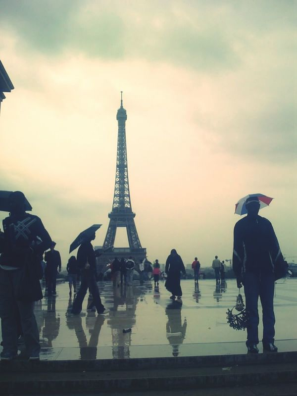 Streetphotography Paris Eiffel Tower Rainy Day Peoplephotography Mirror Reflection_collection Evrybody Street Oldpictureofme Capture The Moment Capturing Movement Twillight Twilight Filmcamera Seeing The Sights Learn & Shoot: After Dark Eifel Tower