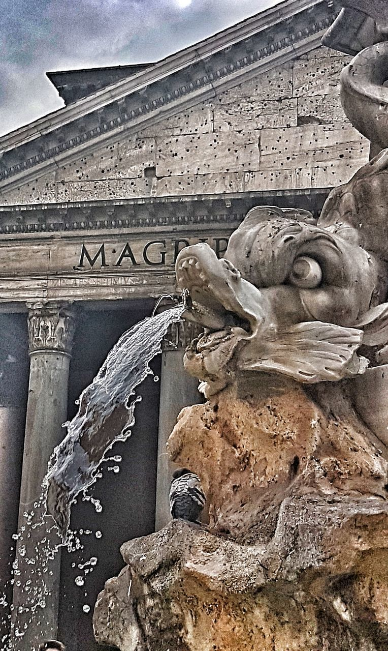 sculpture, statue, art and craft, stone material, history, human representation, architecture, built structure, carving - craft product, text, travel destinations, low angle view, no people, building exterior, monument, bas relief, memorial, day, outdoors, ancient, ancient civilization, sky, close-up
