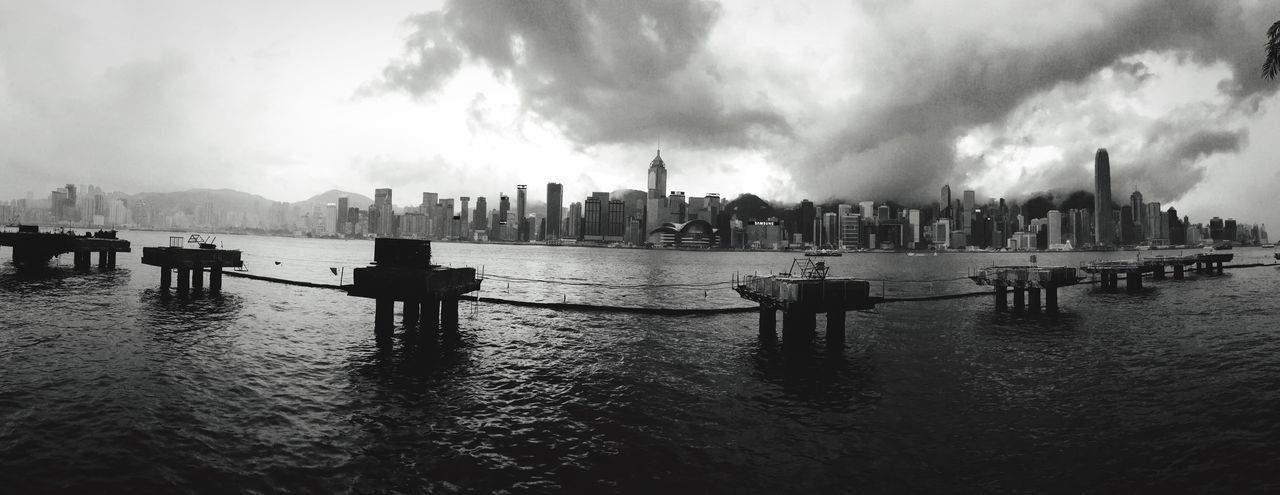 Hong Kong Skyline Black & White Light And Dark Urban Geometry Cityscape IPhoneography Hong Kong Architecture Buildings & Sky Reflections And Shadows Harbourfront Victoria Harbour Sky And Clouds Building And Sky Hong Kong Harbour Light And Shadow Construction Site Rainy Days Monochrome