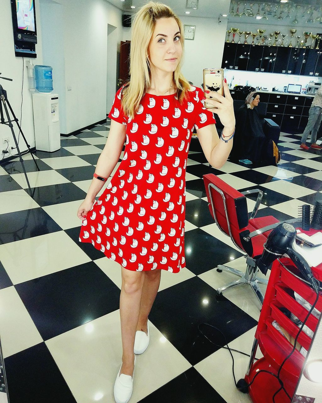 polka dot, fashion, real people, one person, lifestyles, leisure activity, red, young adult, standing, beautiful woman, choice, full length, indoors, retail, customer, blond hair, young women, glamour, portrait, day