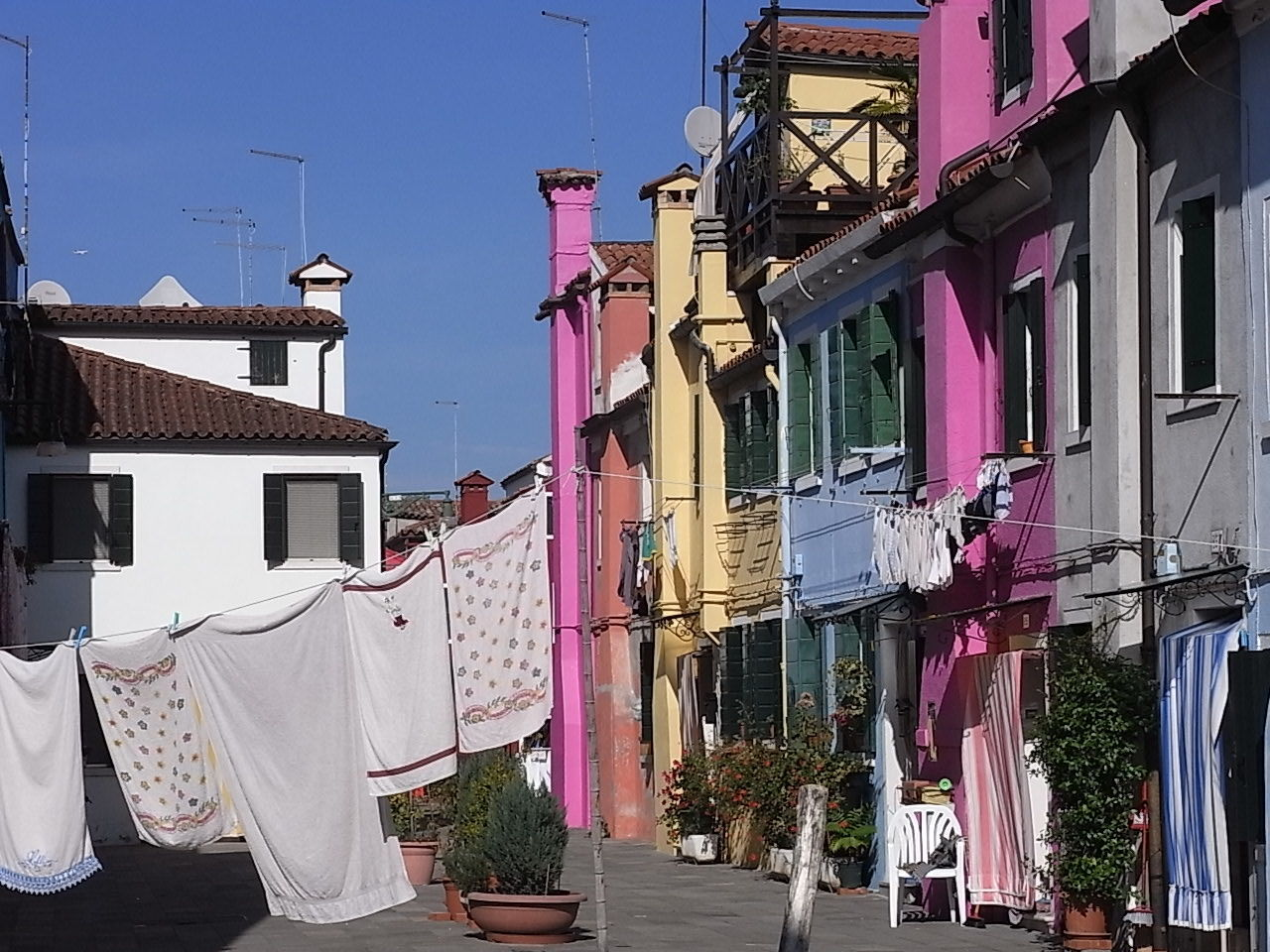 My Year My View Burano Italy Close To Venice . Perfect Place For Pastel Colors And Blue Sky . Dolce Vita Colourful Colourful Houses Old Houses Burano, Venice Outdoors No People Colorful Color Palette Clothes Hanging Village Blue Sky Houses Channel Travel Travel Destinations Travelphotography EyeEm Best Shots