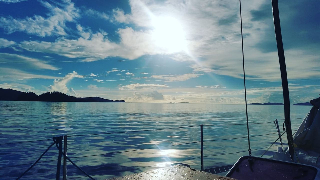 sky, sunlight, sunbeam, cloud - sky, water, nature, sun, scenics, beauty in nature, no people, tranquility, sea, tranquil scene, outdoors, day, nautical vessel