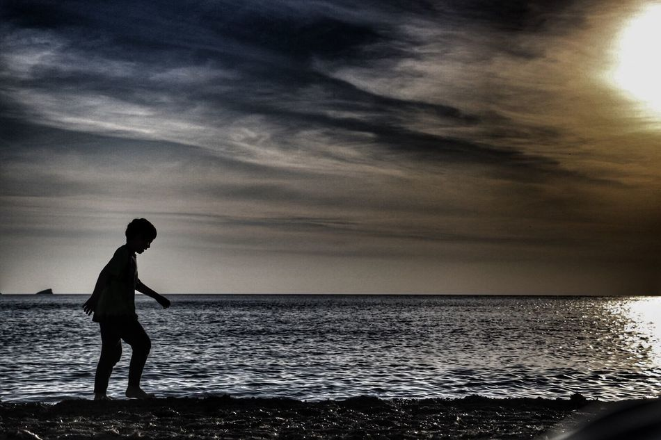 Child at sunset Sunset Silhouettes Canonphotography Real People Sea Sunset Art Is Everywhere Blackandwhite Canon70d Bnw Sea And Sky Ibiza Eivissa Childhood Child Children Photography