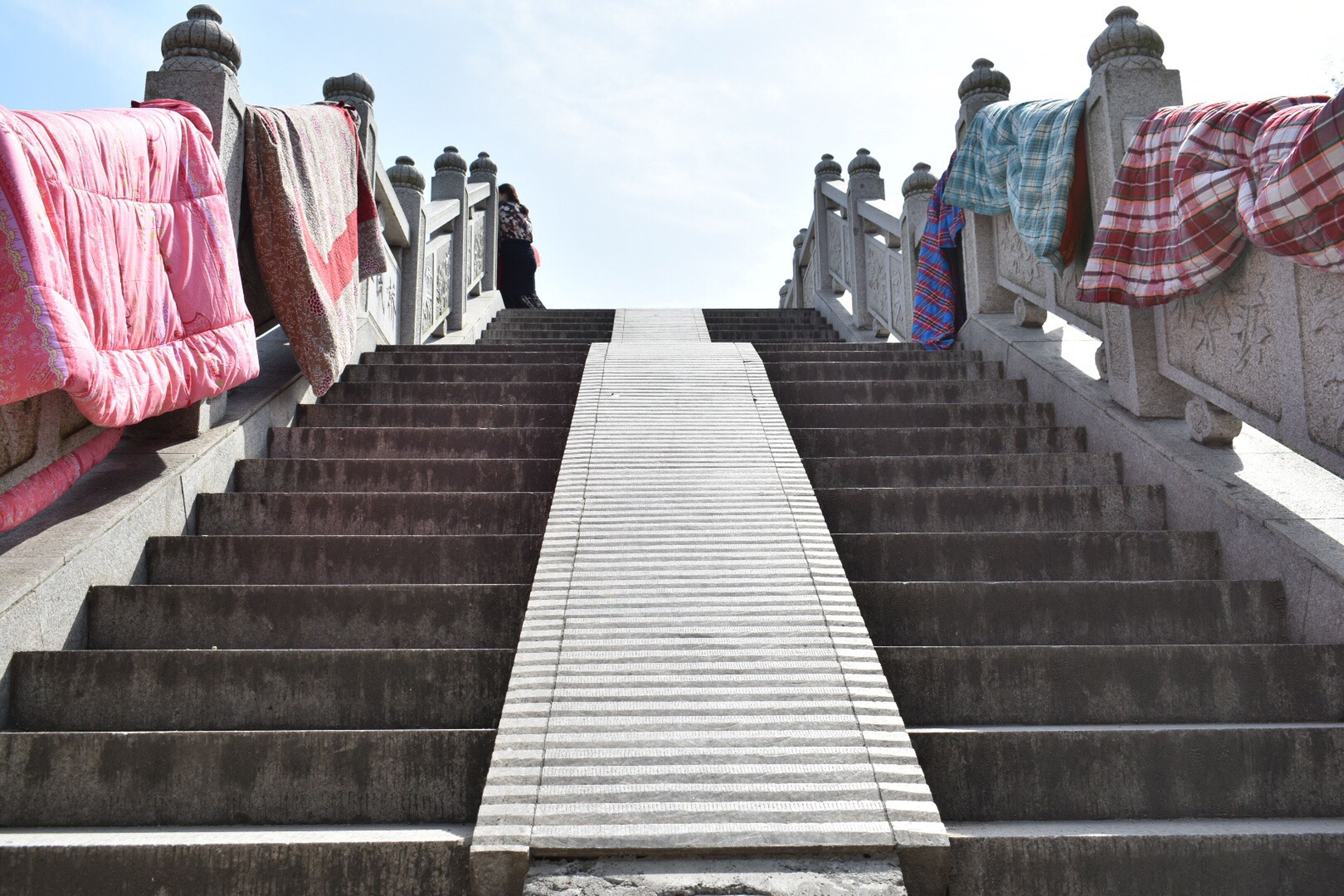 steps, the way forward, sky, low angle view, railing, steps and staircases, staircase, day, outdoors, no people