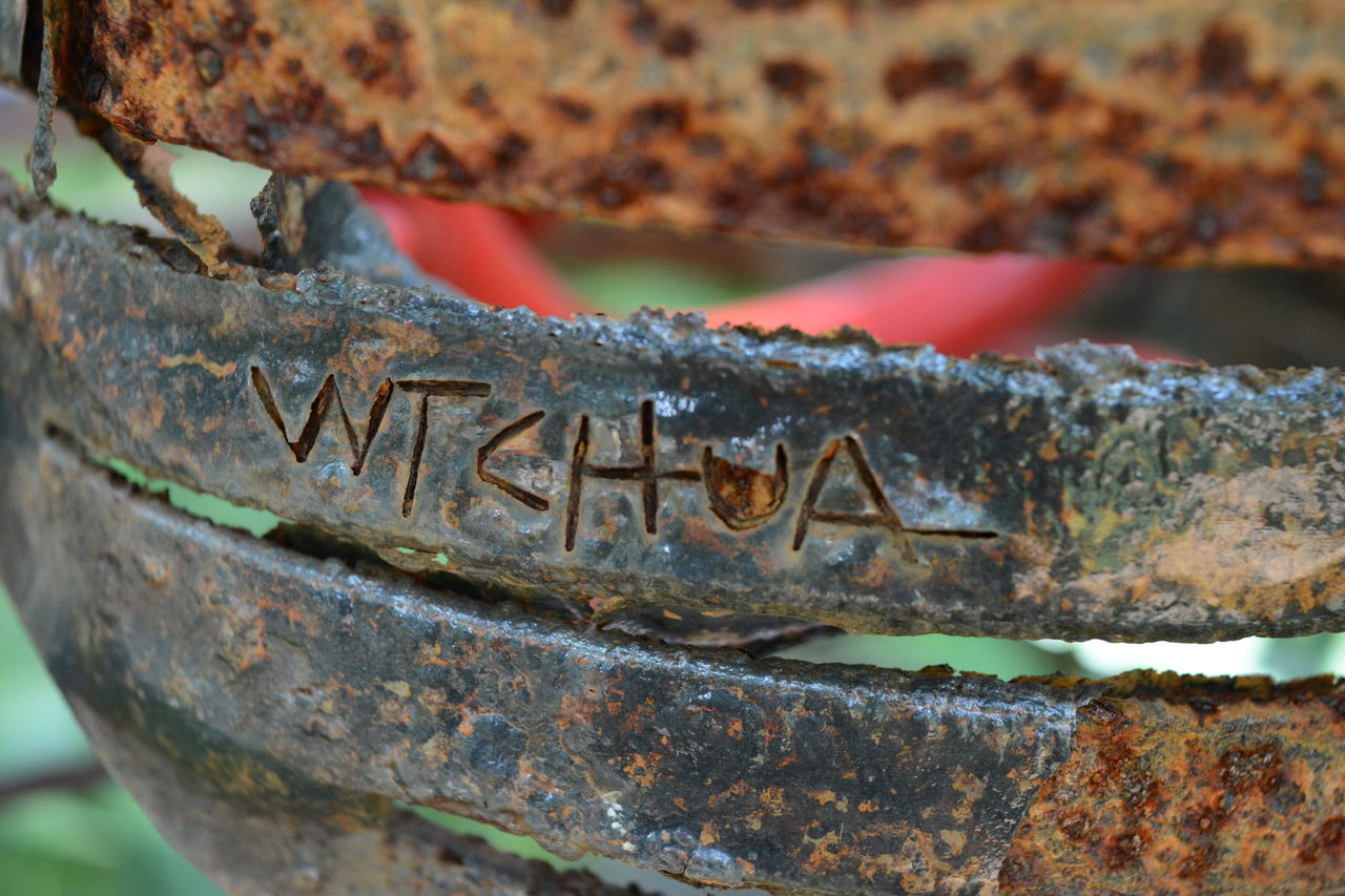 metal, no people, outdoors, close-up, day, water, rusty, focus on foreground, nautical vessel