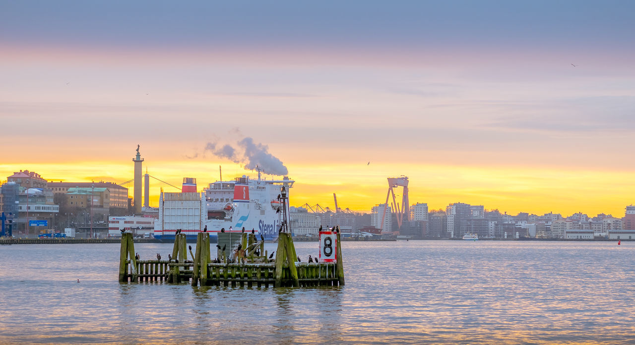 Architecture Business Business Finance And Industry Cityscape Consumerism Finance And Economy Gas Industry Nautical Vessel No People Outdoors Sea Shipping  Sky Sunset Urban Skyline Water