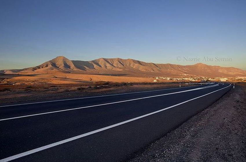 Cycling over 50km and saw this beautiful view over a quiet road. | Fuertuventura, Spain Travel SPAIN Fuerteventura