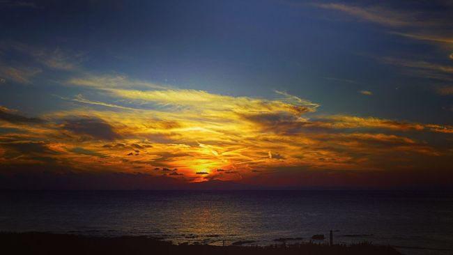 Sea Horizon Over Water Sunset Water Scenics Tranquil Scene Tranquility Idyllic Beauty In Nature Sky Beach Nature Orange Color Cloud Calm Cloud - Sky Seascape Dramatic Sky Remote Ocean