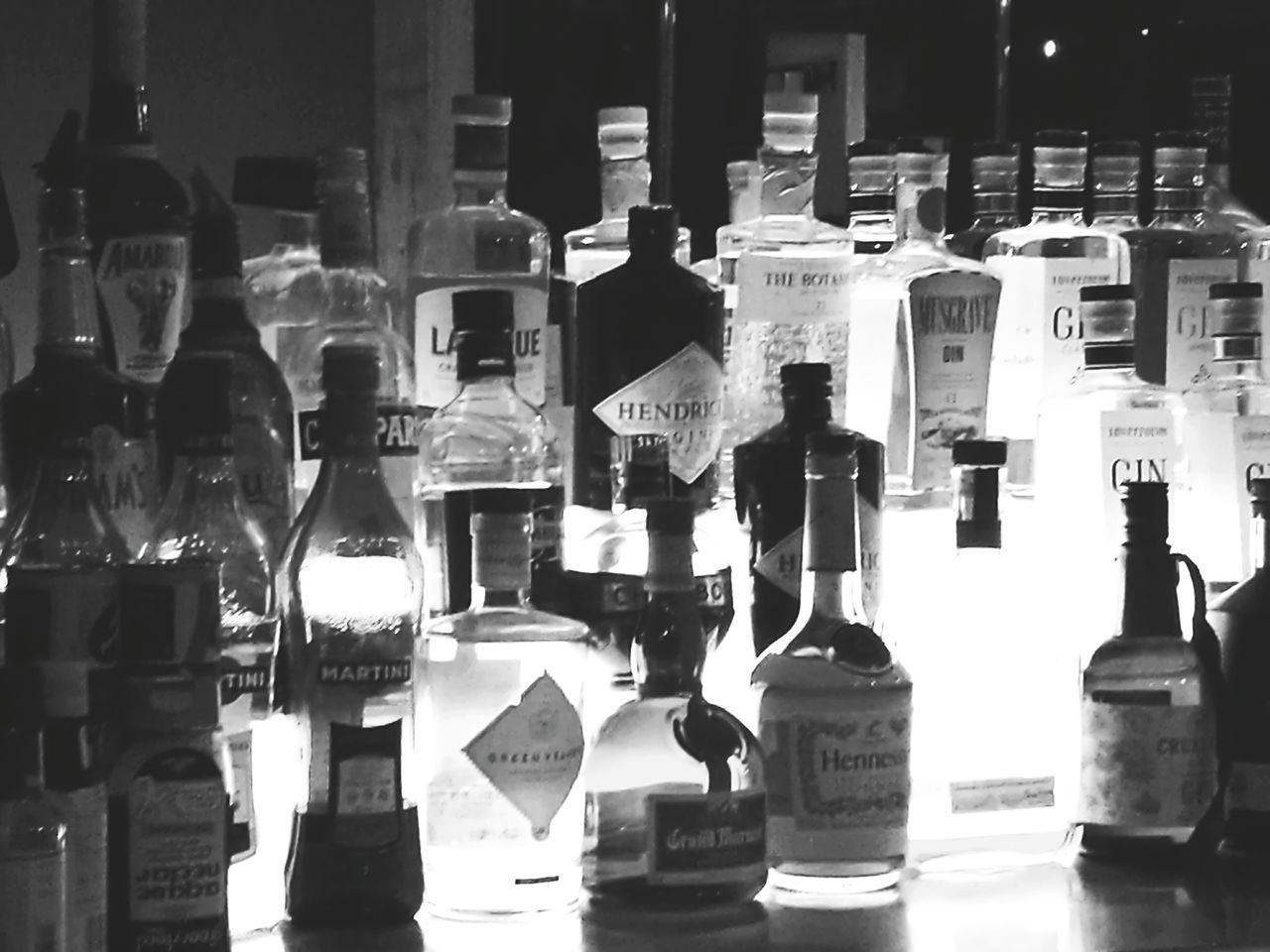 Monochrome Photography Large Group Of Objects Variation Choice Multi Colored Arrangement Variation Choice Large Group Of Objects Multi Colored Arrangement Collection Shelf Order Retail  Freshness No People All Different Types Of Gin Stunning Beauty  Display Shelf In A Bar Overnight Success
