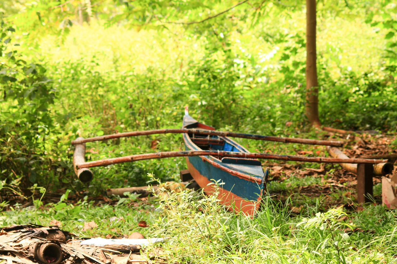 Stranded and out of place Grass Nature Outdoors Green Color No People Old And Worn Decay Old Boat Dilapidated Junk Fishing Boats Conceptual