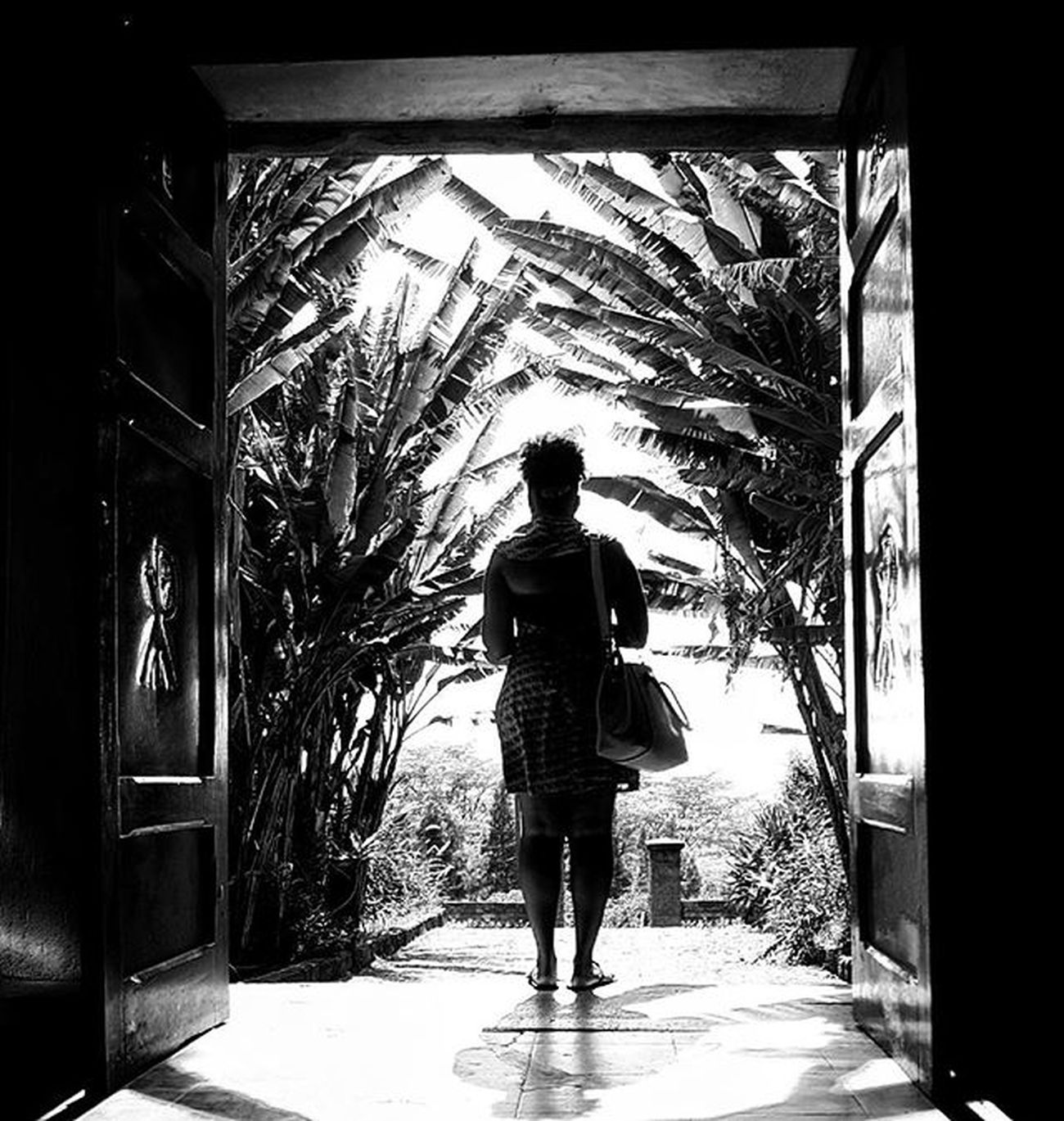 The girl indoors _ 365photoproject 365photochallenge Day37 Vscokenya Vscocam VSCO Vscogood Igkenya Igersnairobi Kenya365 Igers Instagood Fujifilm Xt1 Monochrome Blackandwhite Photooftheday Picoftheday Doors Architecture Travel Design Light Beautiful Sun palmtree paradise view nairobi kenya
