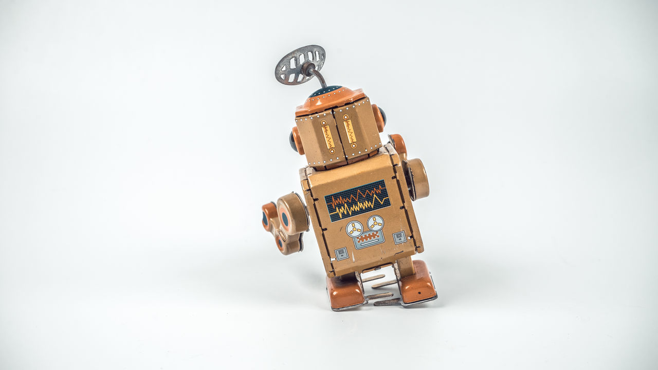 Retro styled or retro color worn out and rusty vintage tin robot. Slightly de-focused and close-up shot. Copy space. Broken Machine Play Radar Rustic Studio Shot Tin Can Vintage Vintage Cars White Background Worn Out Worn Out & Wonderful