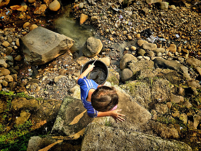 a kid go to river to catch some fish Children's Portraits Day High Angle View Kids Nature Outdoors River View Rock