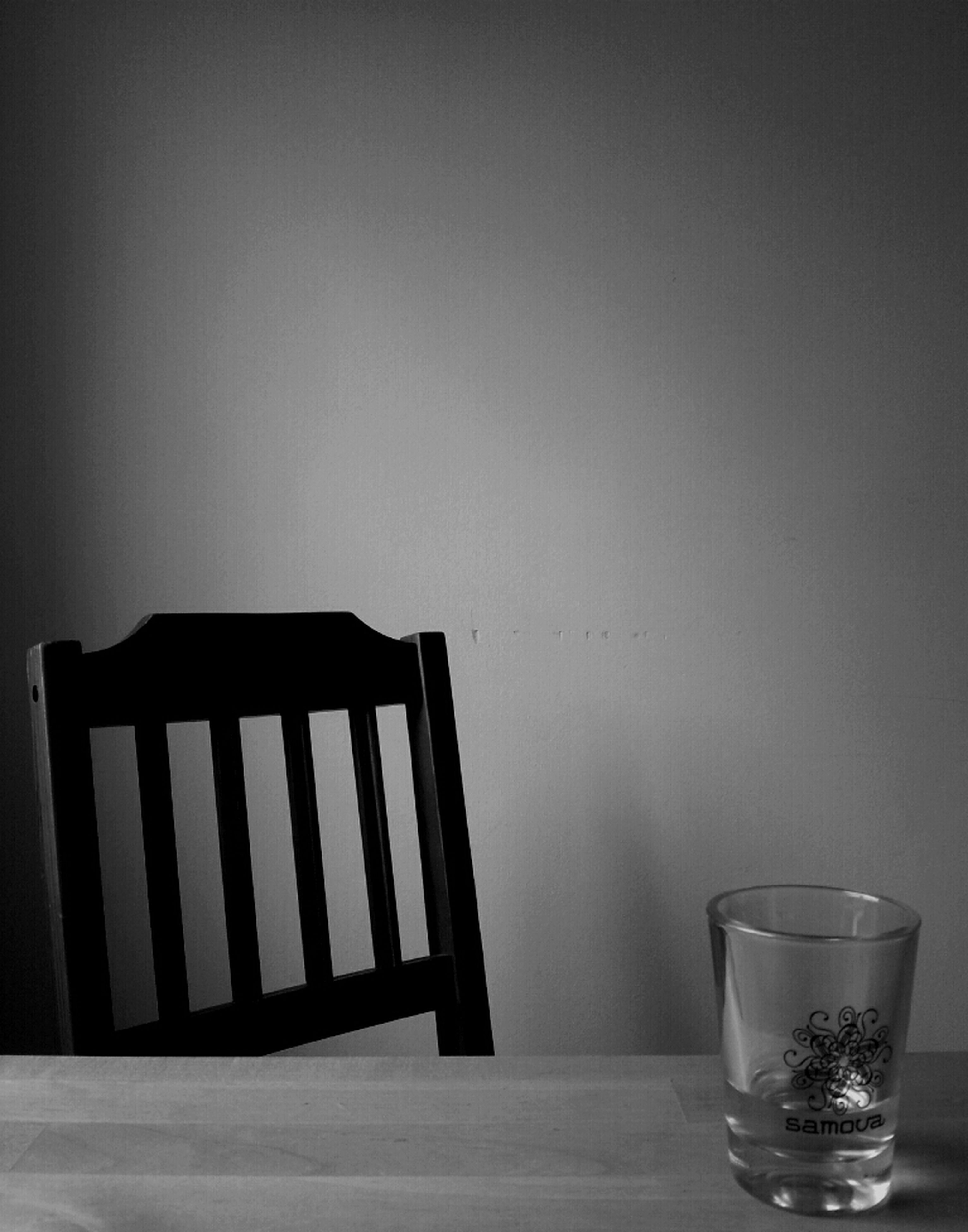 indoors, table, still life, copy space, empty, home interior, chair, vase, drink, absence, wood - material, close-up, drinking glass, food and drink, no people, wall - building feature, glass - material, refreshment, studio shot, arrangement