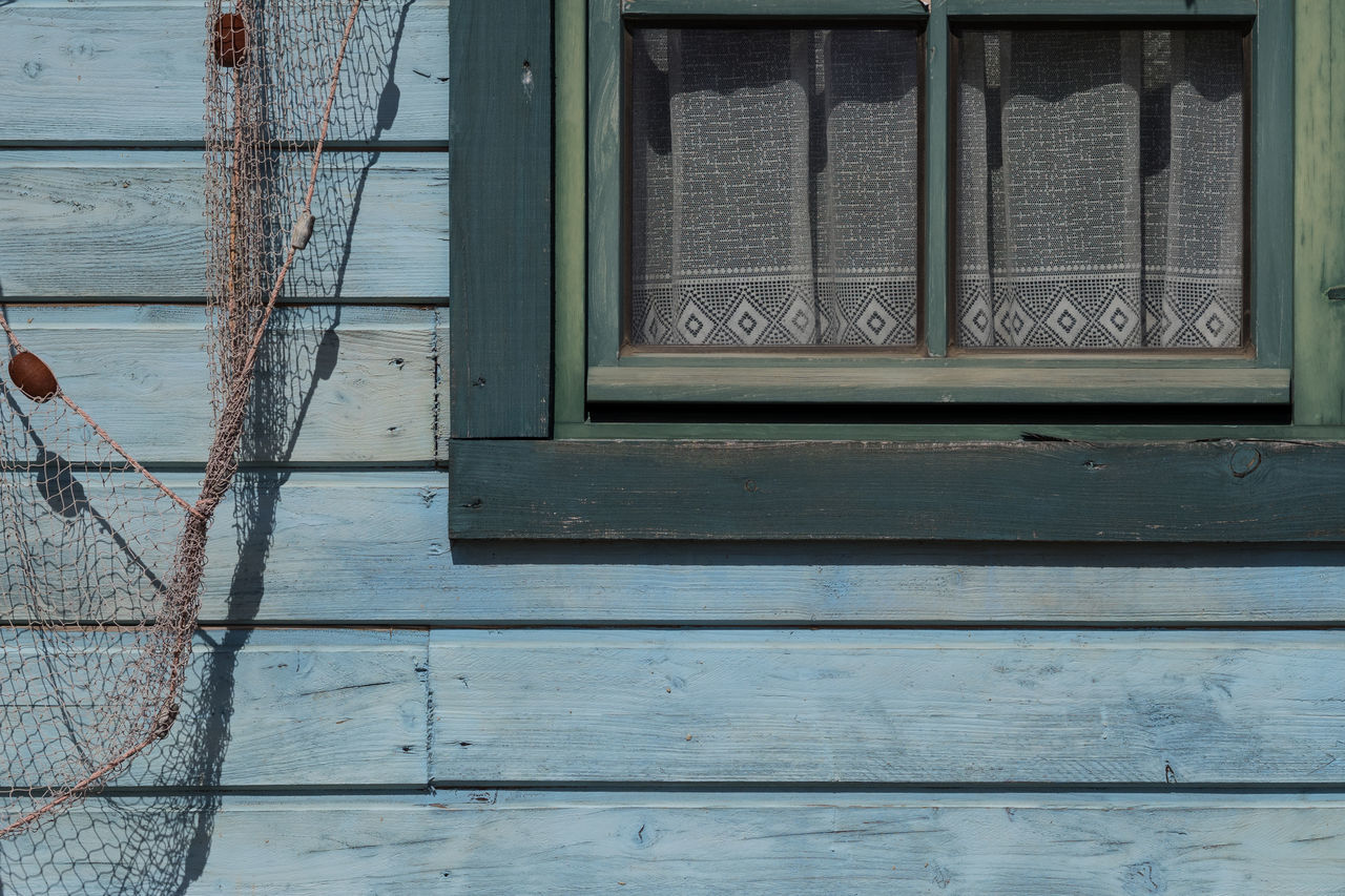 Detail of an old house with parts of a fisherman net to the left Architecture Blue Wooden Wall Building Exterior Built Structure Close-up Day Fishermen Net No People Outdoors Window Window Frame
