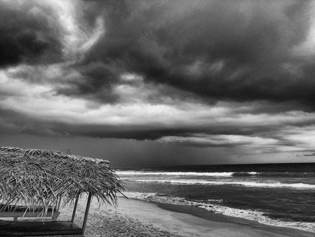 Monochrome PhotographyNarigama Beach, Sri Lanka Sri Lanka SriLanka Beach Storm Storm Clouds Weather Waves Ocean Hut Blackandwhite Destination Holiday Raw Beauty Vacation Surf Clouds And Sky Cloudy Nexus6 Water Wave Travel Destinations Sea Shore Sand