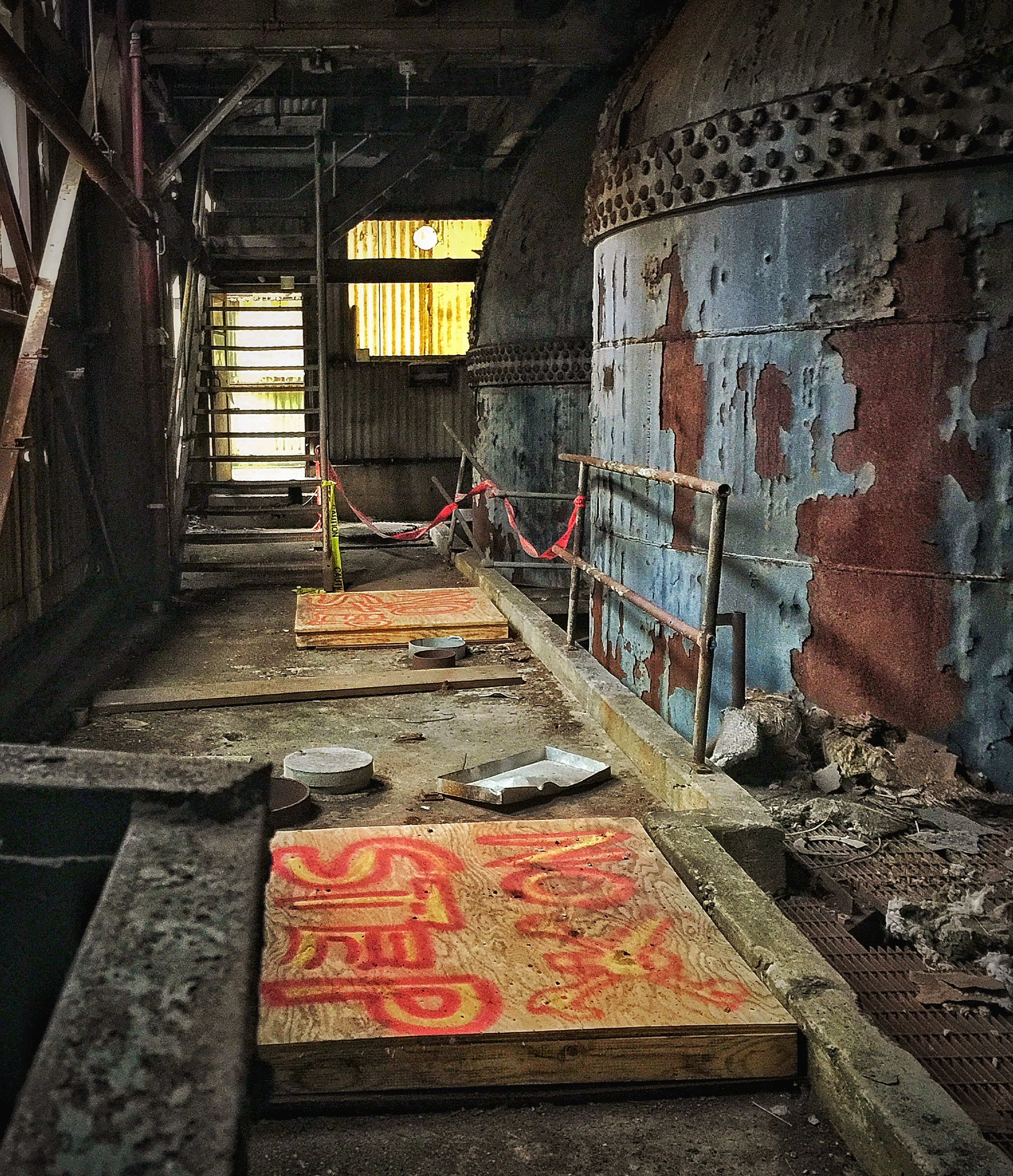 architecture, built structure, graffiti, steps, abandoned, building exterior, indoors, wall - building feature, staircase, day, full length, steps and staircases, railing, brick wall, damaged, metal, obsolete, red, house