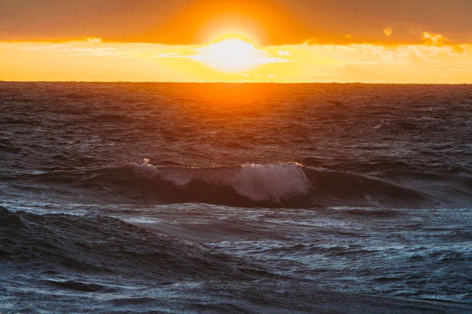 Sunset Orange Color Dramatic Sky Beauty In Nature Sunlight Travel Sea Travel Destinations Sun Sky Landscape Tourism Summer Tranquility Journey Nature No People Horizon Beach Romantic Sky Sunrise