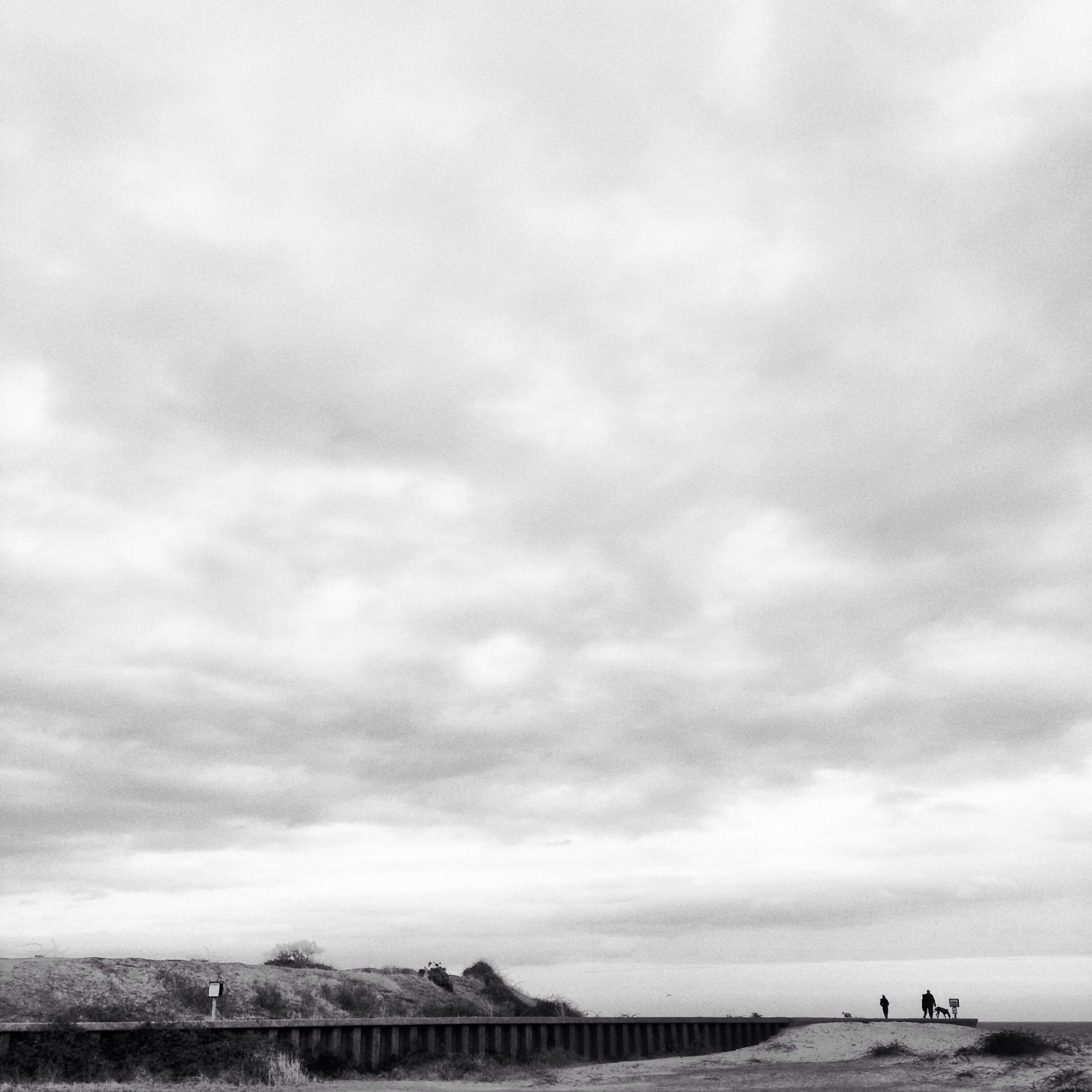 sky, sea, cloud - sky, water, cloudy, beach, horizon over water, built structure, architecture, shore, incidental people, cloud, nature, day, overcast, transportation, building exterior, outdoors, scenics
