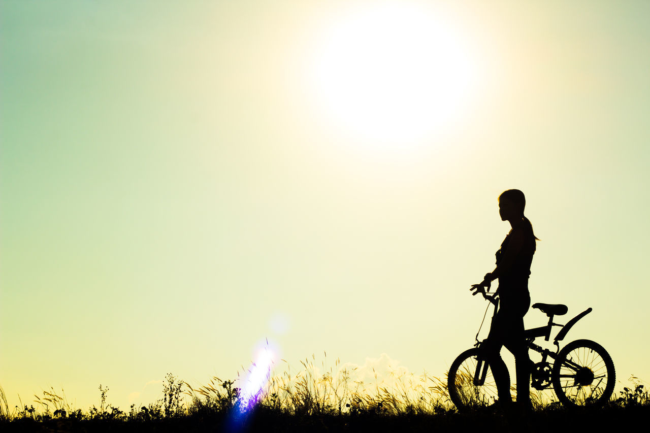 Adult Adults Only Adventure Bicycle Cycling Day Headwear Healthy Lifestyle Men Motorcycle Racing Mountain Bike Nature One Man Only One Person Only Men Outdoors Pedal People Silhouette Sky Sunlight Sunset Young Adult