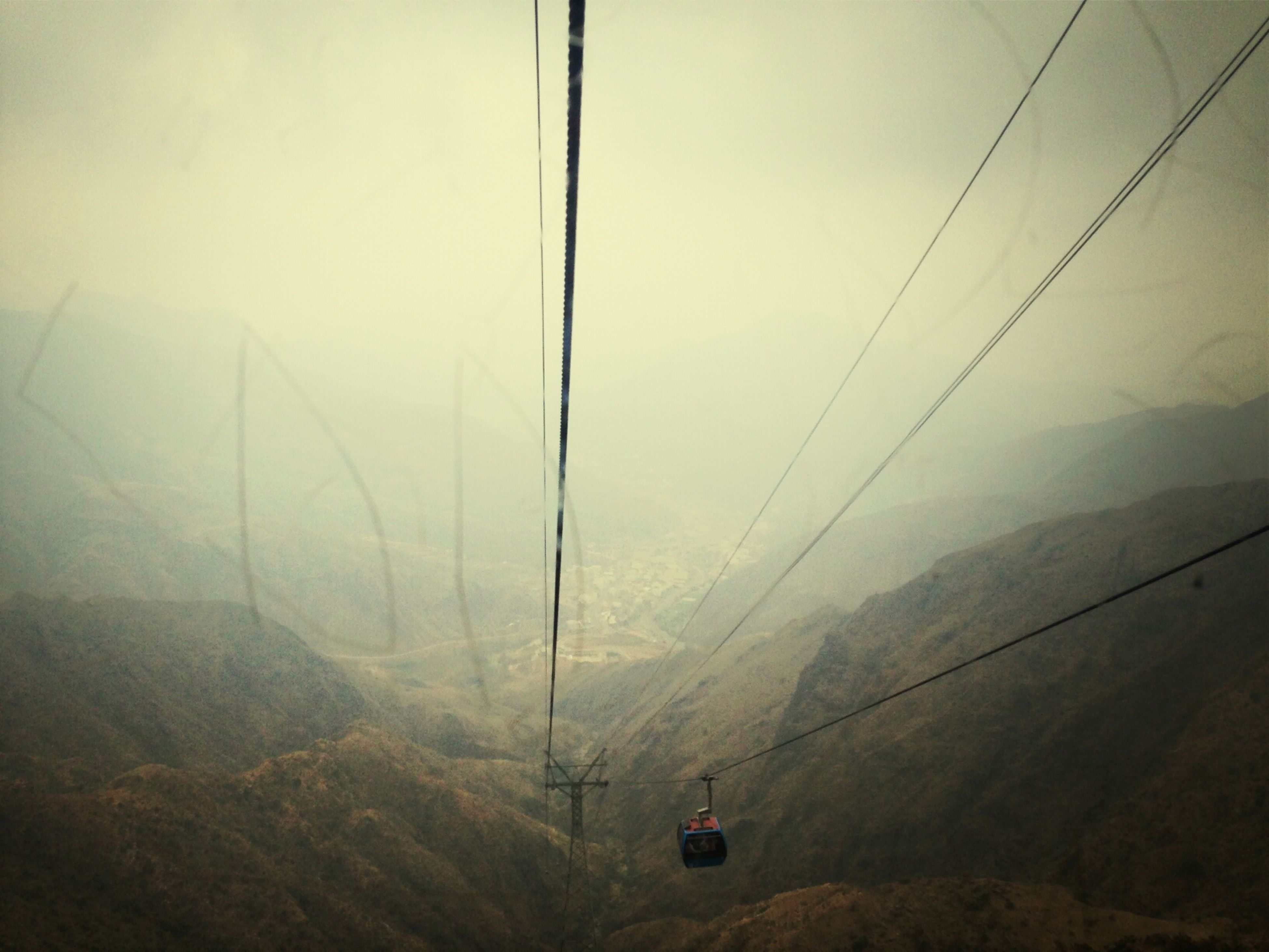 transportation, power line, mountain, connection, electricity pylon, electricity, cable, sky, overhead cable car, tranquility, power supply, fog, tranquil scene, mode of transport, scenics, nature, landscape, beauty in nature, fuel and power generation, technology