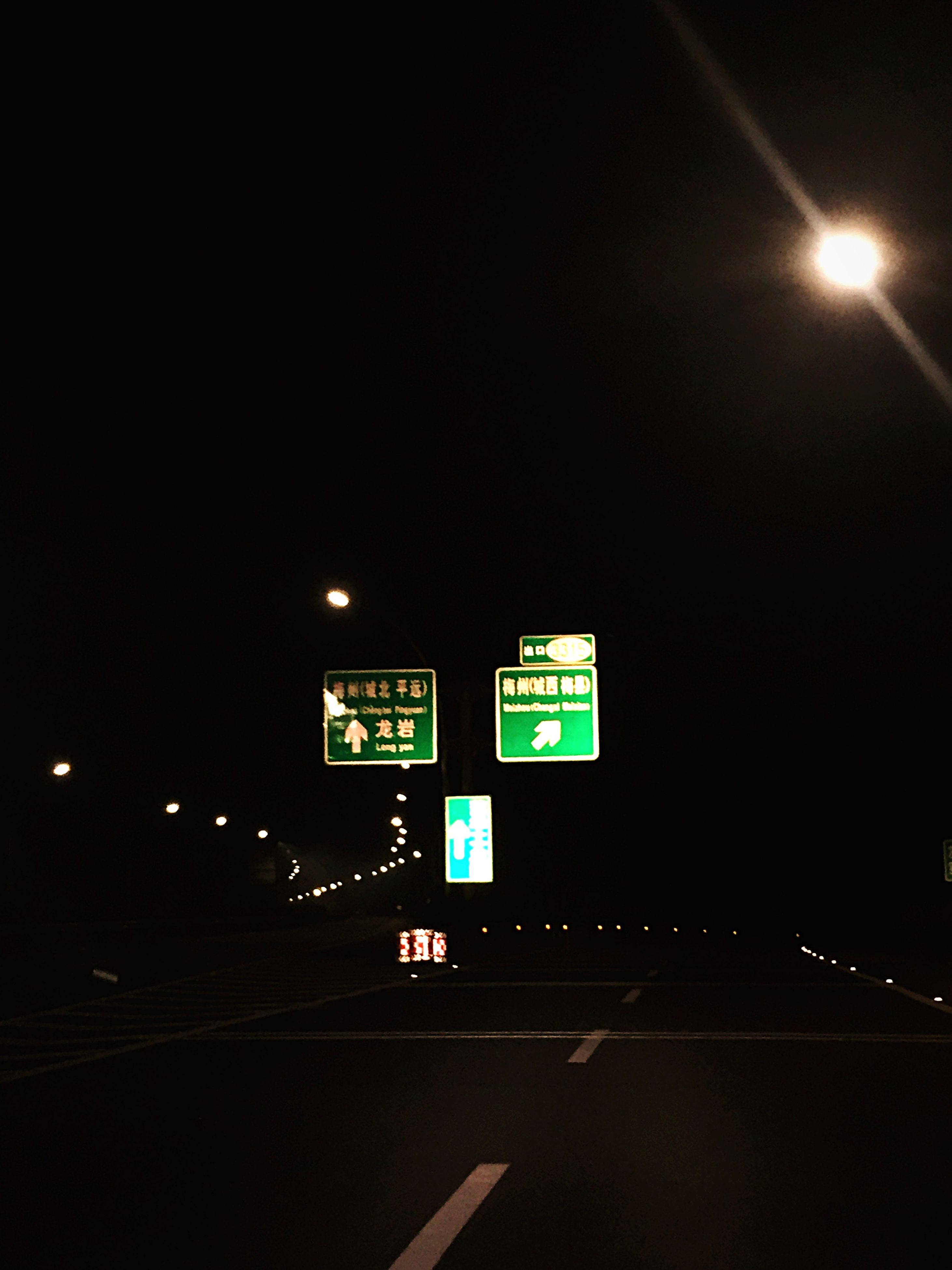 illuminated, night, communication, text, western script, guidance, information sign, arrow symbol, sign, transportation, directional sign, information, clear sky, road sign, road, direction, copy space, number, capital letter, lighting equipment