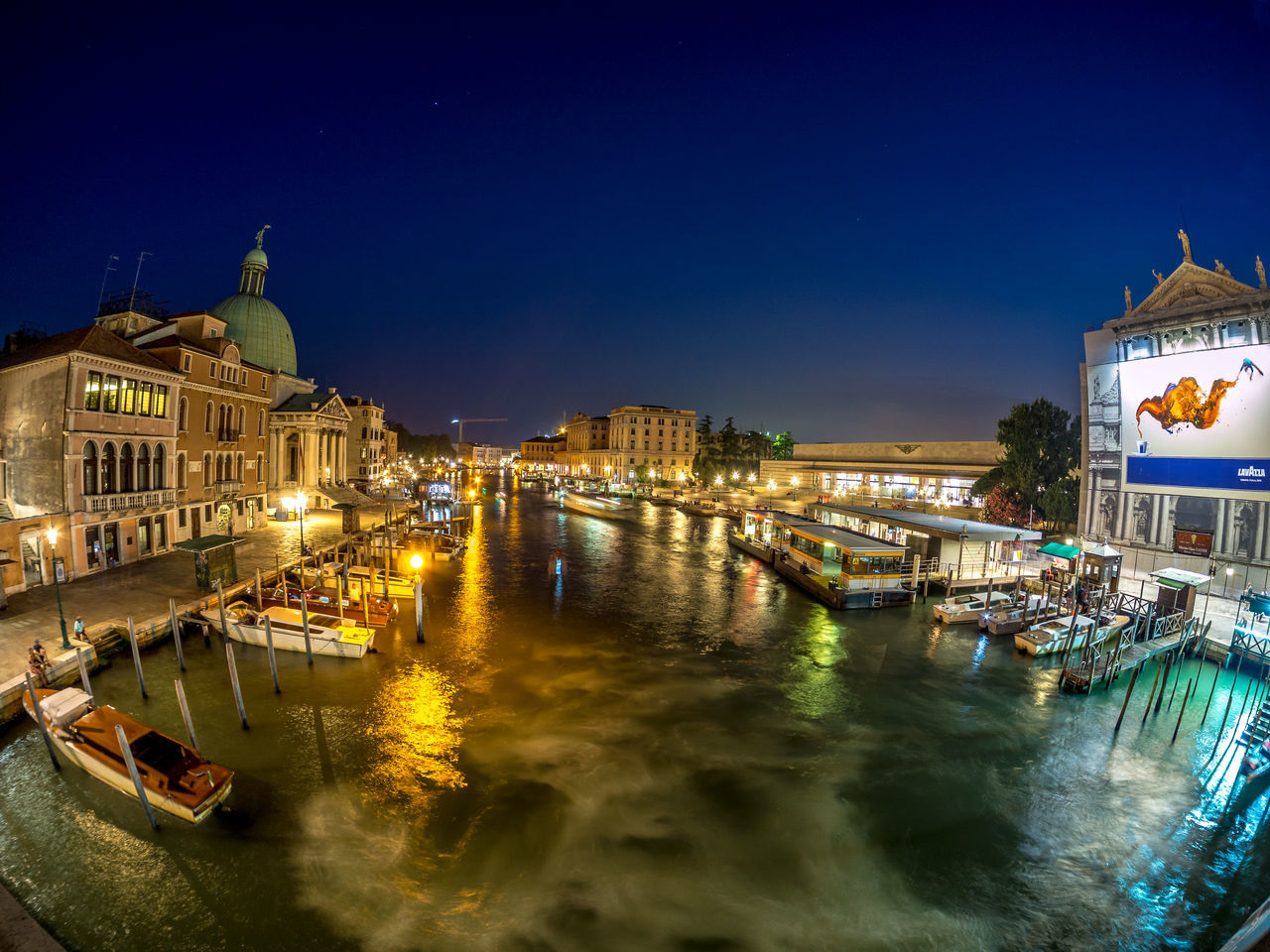 architecture, building exterior, night, built structure, water, illuminated, nautical vessel, high angle view, transportation, mode of transport, outdoors, city, waterfront, no people, travel destinations, moored, cityscape, clear sky, sky