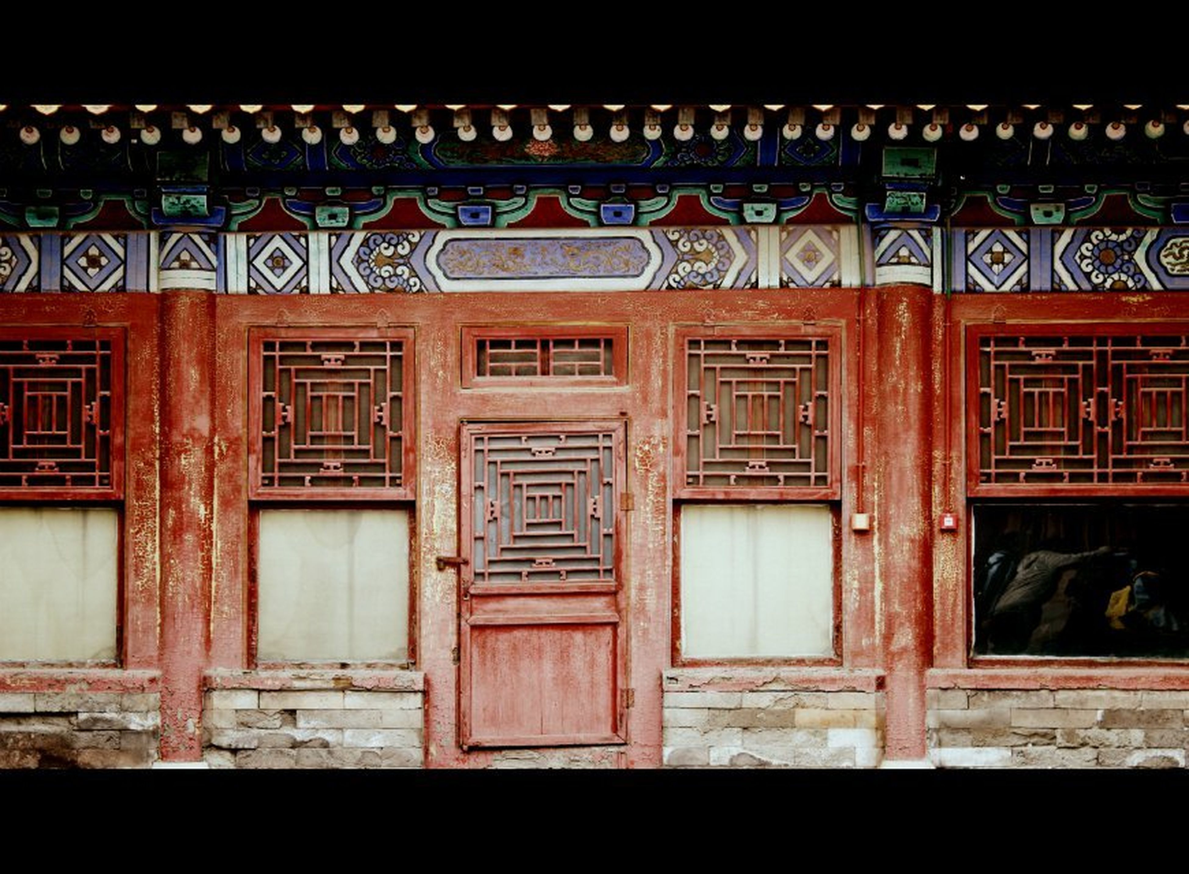 architecture, built structure, building exterior, text, western script, door, window, communication, closed, red, non-western script, night, graffiti, entrance, house, wood - material, no people, outdoors, facade, building