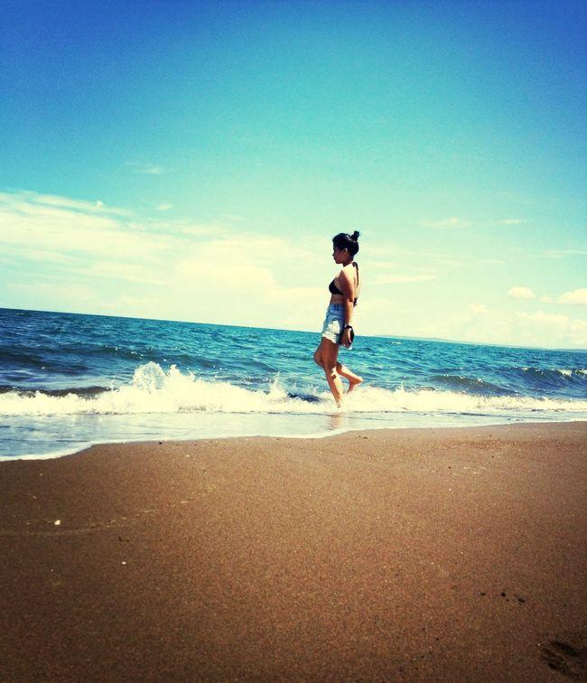 Swimming Enjoying The Sun Getting A Tan On The Beach
