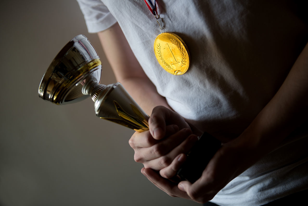 human hand with winner cup Achieve Achievement AWARD Backgrounds Best  Celebration Champion Championship Close-up Competition Conquer Contest Cup Event Golden Cup Human Hand Medal Men One Person People Real People Silver Cup Trophy Winner Young Adult