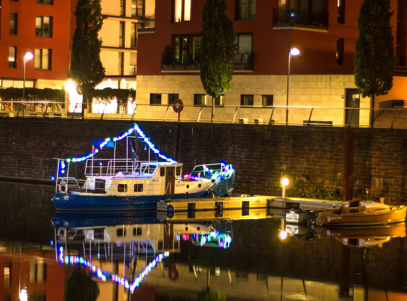 Old Henry, partyboat. Illuminated Night Building Exterior Architecture Reflection Built Structure Transportation City Water Tree No People Christmas Outdoors Christmas Decoration Sky Frankfurt Westhafen Boat Lightchain