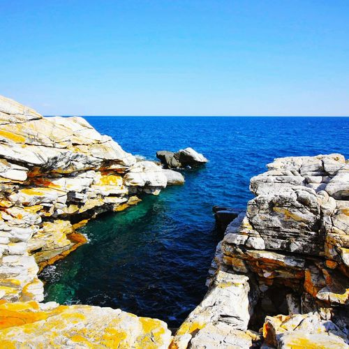 Water Sea Horizon Over Water Rock - Object Blue Clear Sky Scenics Tranquil Scene Beauty In Nature Copy Space Rock Formation Tranquility Nature Day Rocky Remote Outdoors Non-urban Scene Rocky Coastline Shore