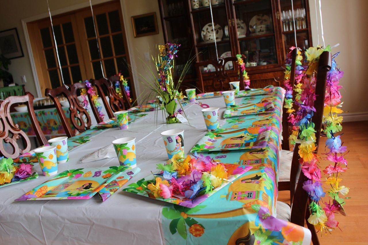Decorative Tablecloth And Artificial Flowers Arranged On Dining Table At Home