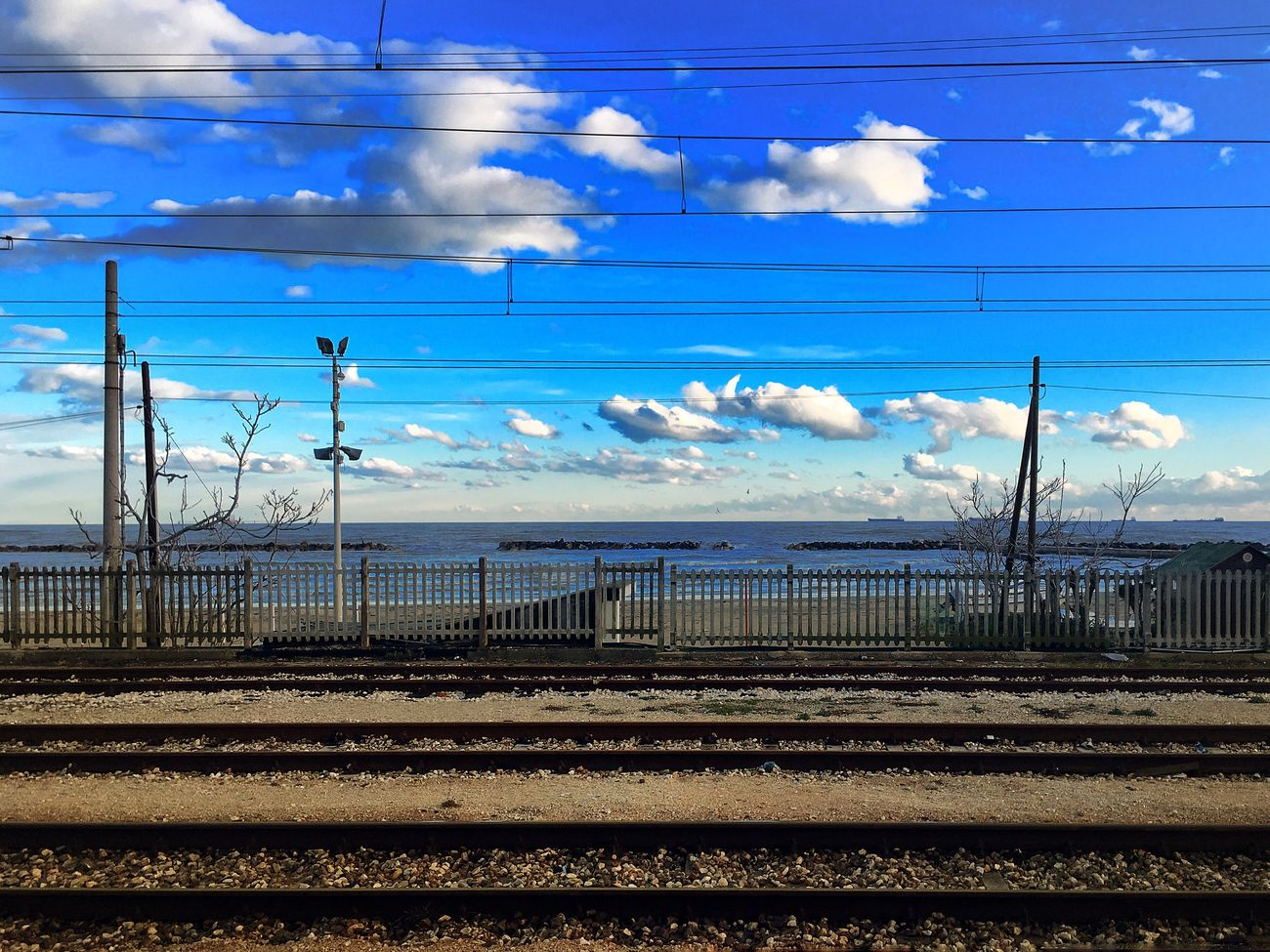 Title: nubes y vía férrea Sky And Clouds Sky Rail Transport Cloud - Sky Electricity  rCable Blue ePower Line  rTransportation tElectricity Pylon Railroad Track Power Supply sOutdoors tNo People pDay lConnection eNature Train First Eyeem Photo IPhoneography Playa Nubes Vía Ferrea