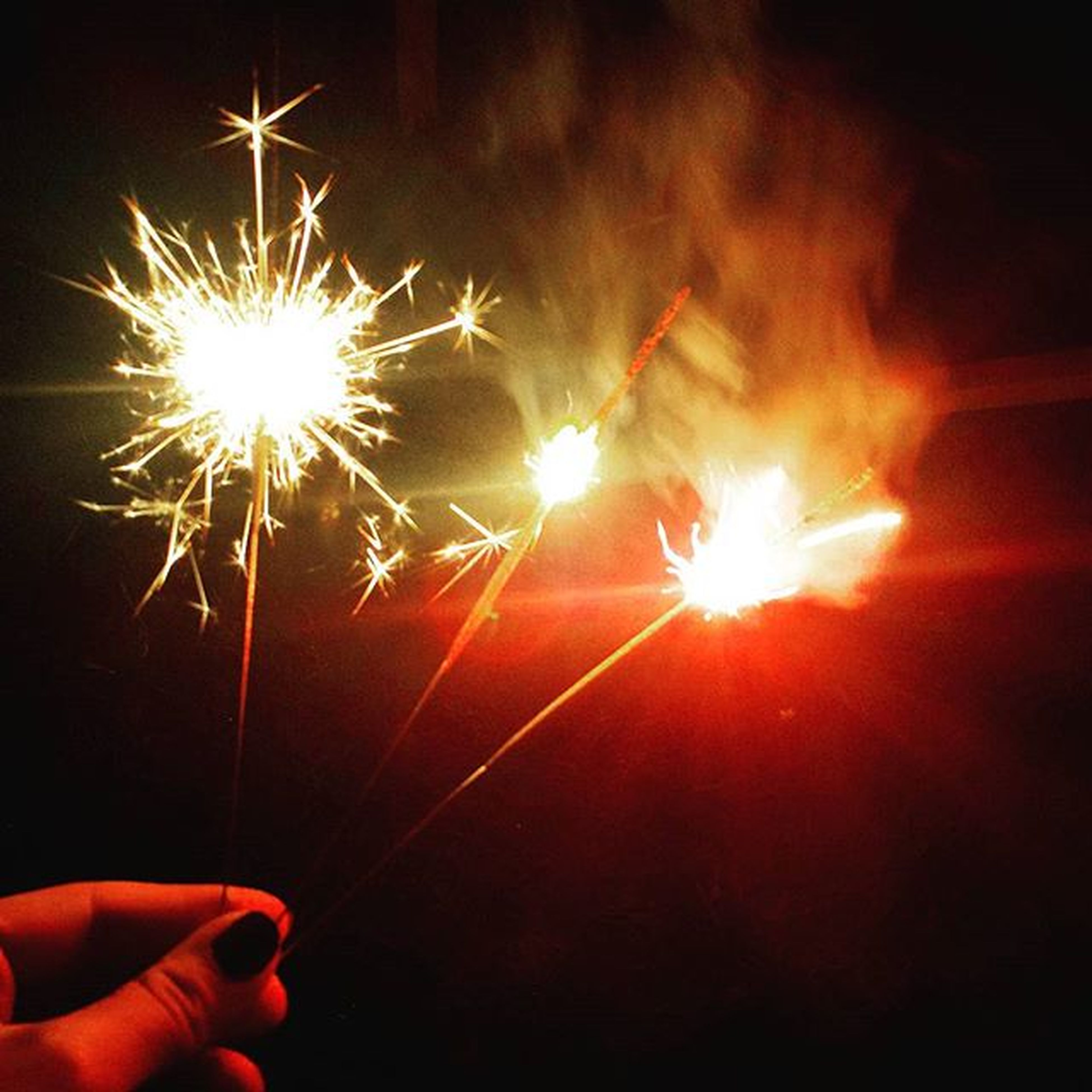 person, night, illuminated, glowing, holding, part of, unrecognizable person, celebration, cropped, burning, human finger, fire - natural phenomenon, event, lifestyles, leisure activity, sparkler, exploding