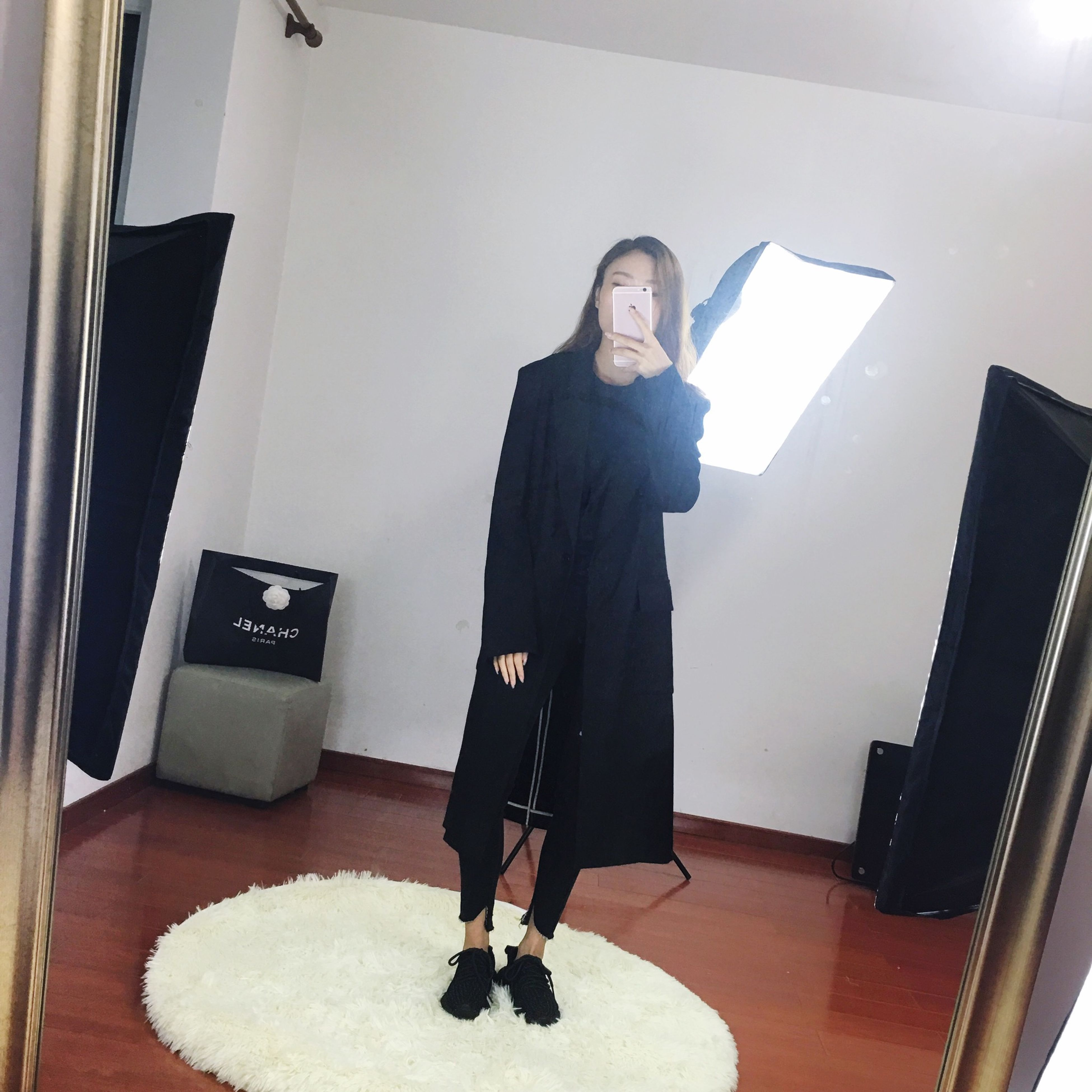 full length, lifestyles, standing, casual clothing, leisure activity, architecture, young adult, built structure, young women, building exterior, three quarter length, rear view, indoors, front view, holding, person, house, warm clothing