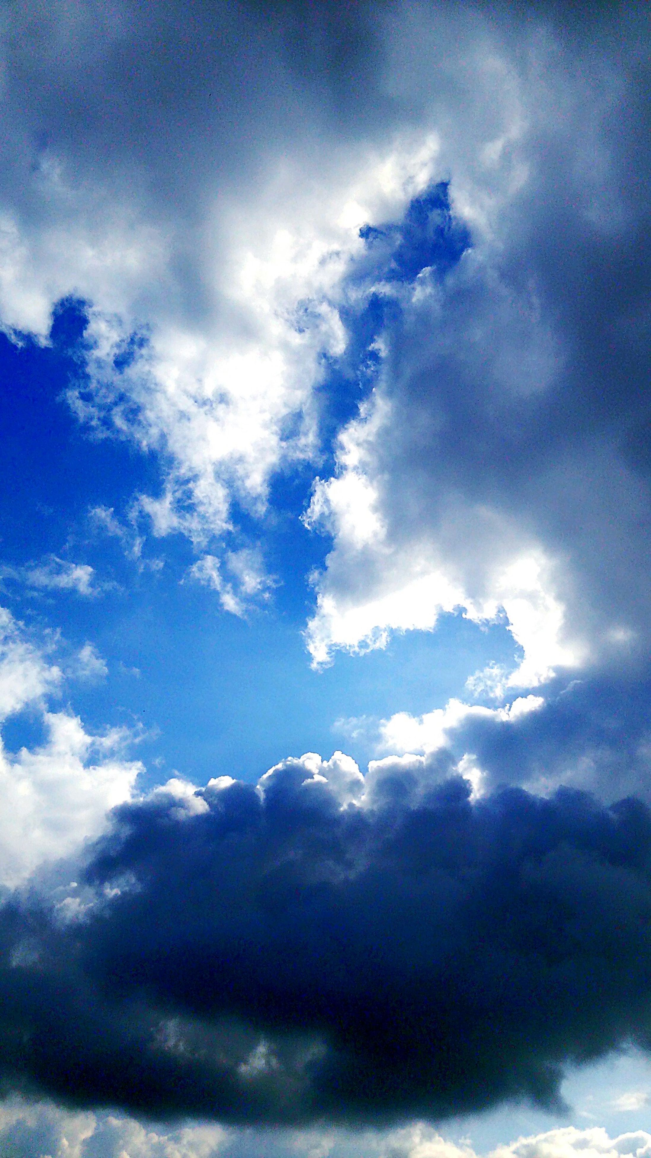 sky, cloud - sky, low angle view, cloudy, sky only, cloudscape, beauty in nature, tranquility, scenics, blue, nature, tranquil scene, cloud, weather, backgrounds, idyllic, fluffy, full frame, white color, majestic