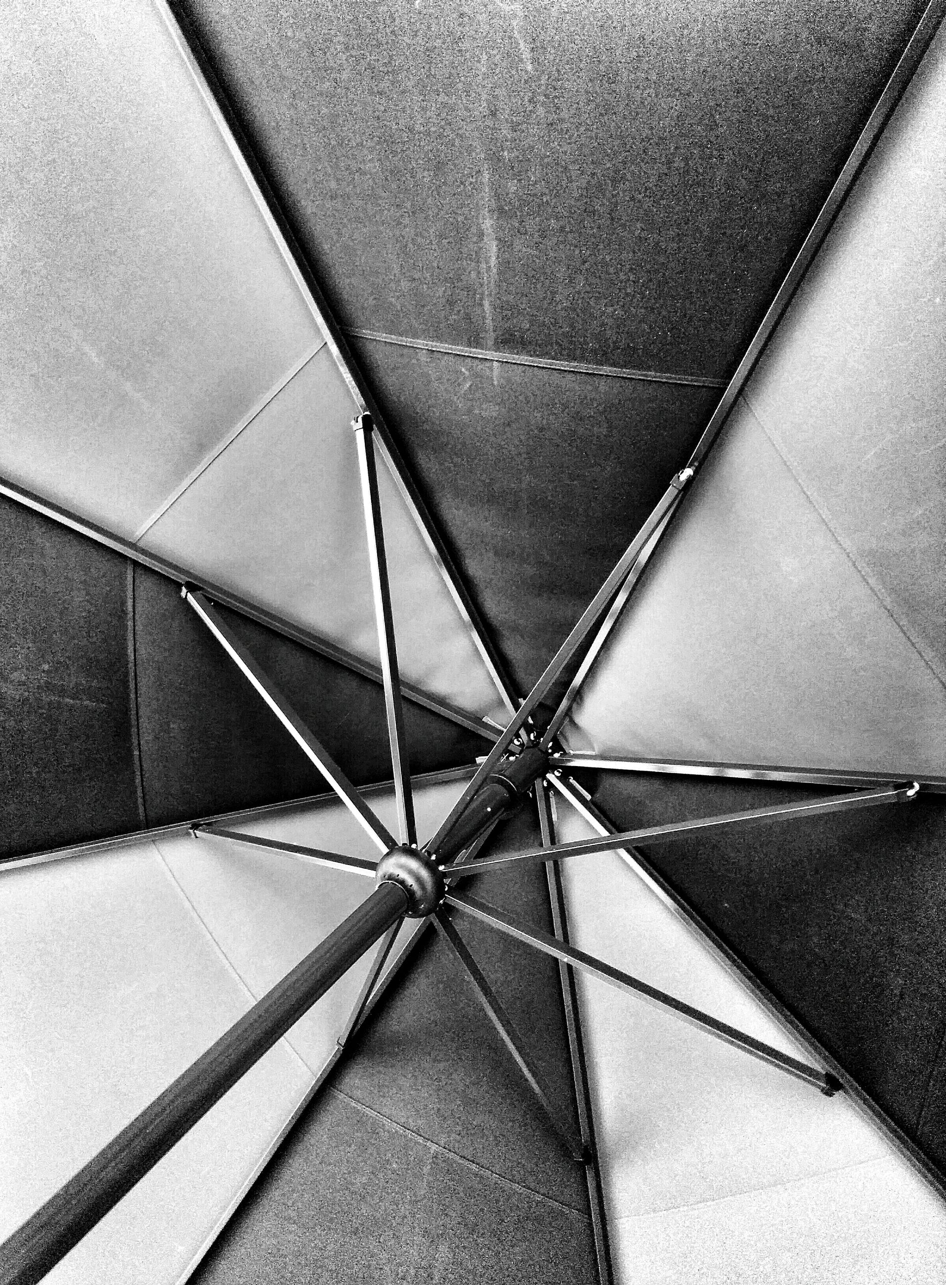 indoors, architecture, built structure, pattern, ceiling, full frame, backgrounds, design, geometric shape, low angle view, directly below, modern, high angle view, no people, day, textured, architectural feature, diminishing perspective, shape, close-up