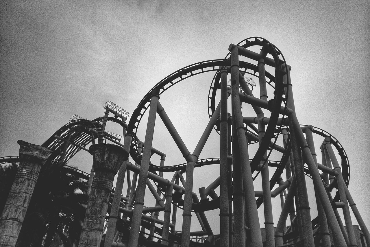 rollercoaster, arts culture and entertainment, metal, low angle view, amusement park, no people, amusement park ride, outdoors, adventure, sky, day