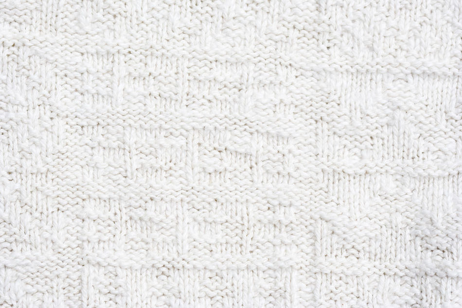 Close-up of a woolen pattern - knitting pattern with purls and knits Backgrounds Close-up Detail Fashion Fiber Full Frame Knit Knitted  Knitting Knitwear Material No People Pattern Repetition Softness Sweater Symmetry Textile Textured  Textured  Textures And Surfaces Warm Warm Clothing White Wool