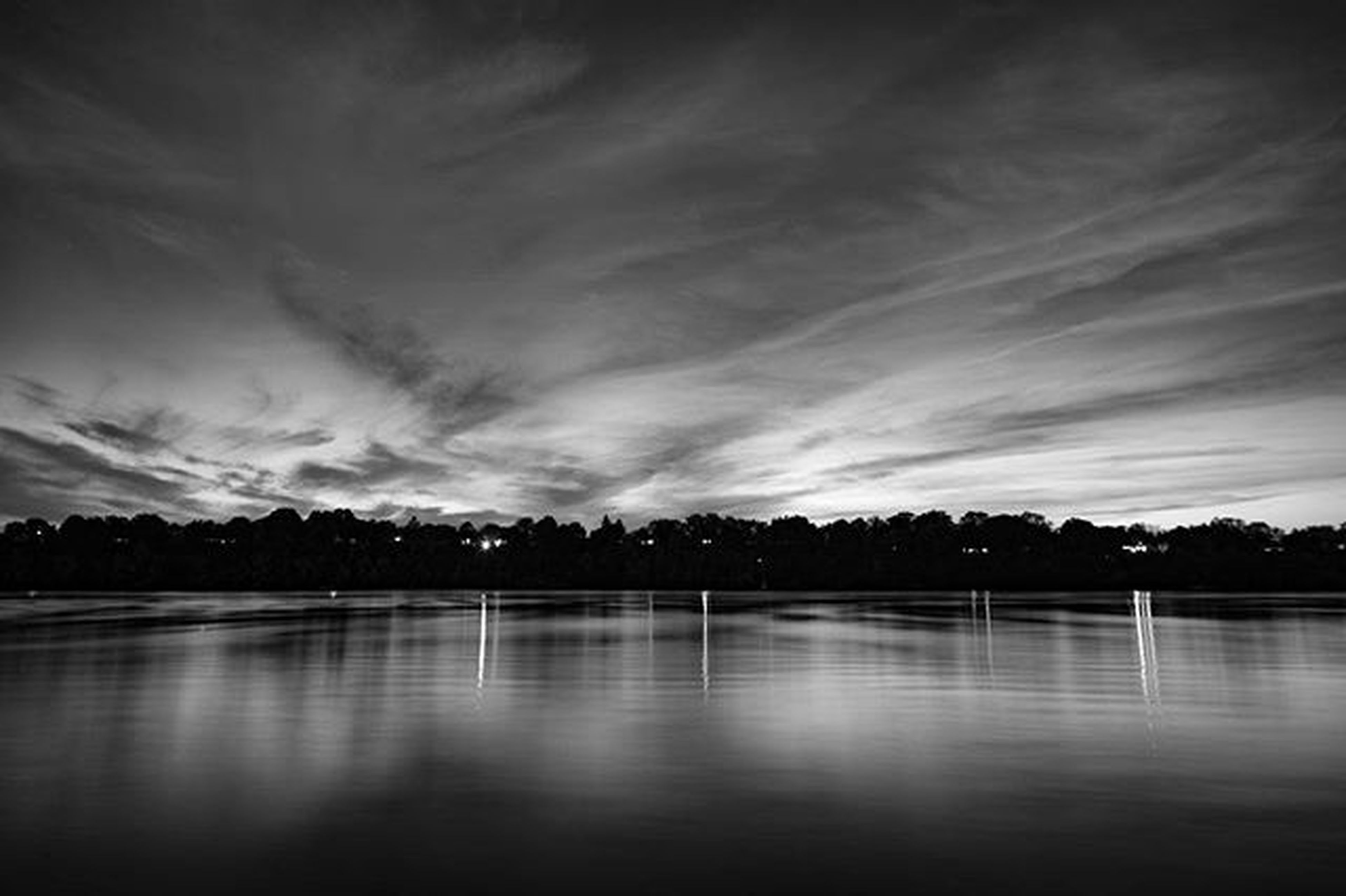 water, tranquil scene, tranquility, sky, waterfront, scenics, reflection, beauty in nature, lake, tree, cloud - sky, nature, silhouette, idyllic, cloudy, cloud, sunset, calm, river, dusk