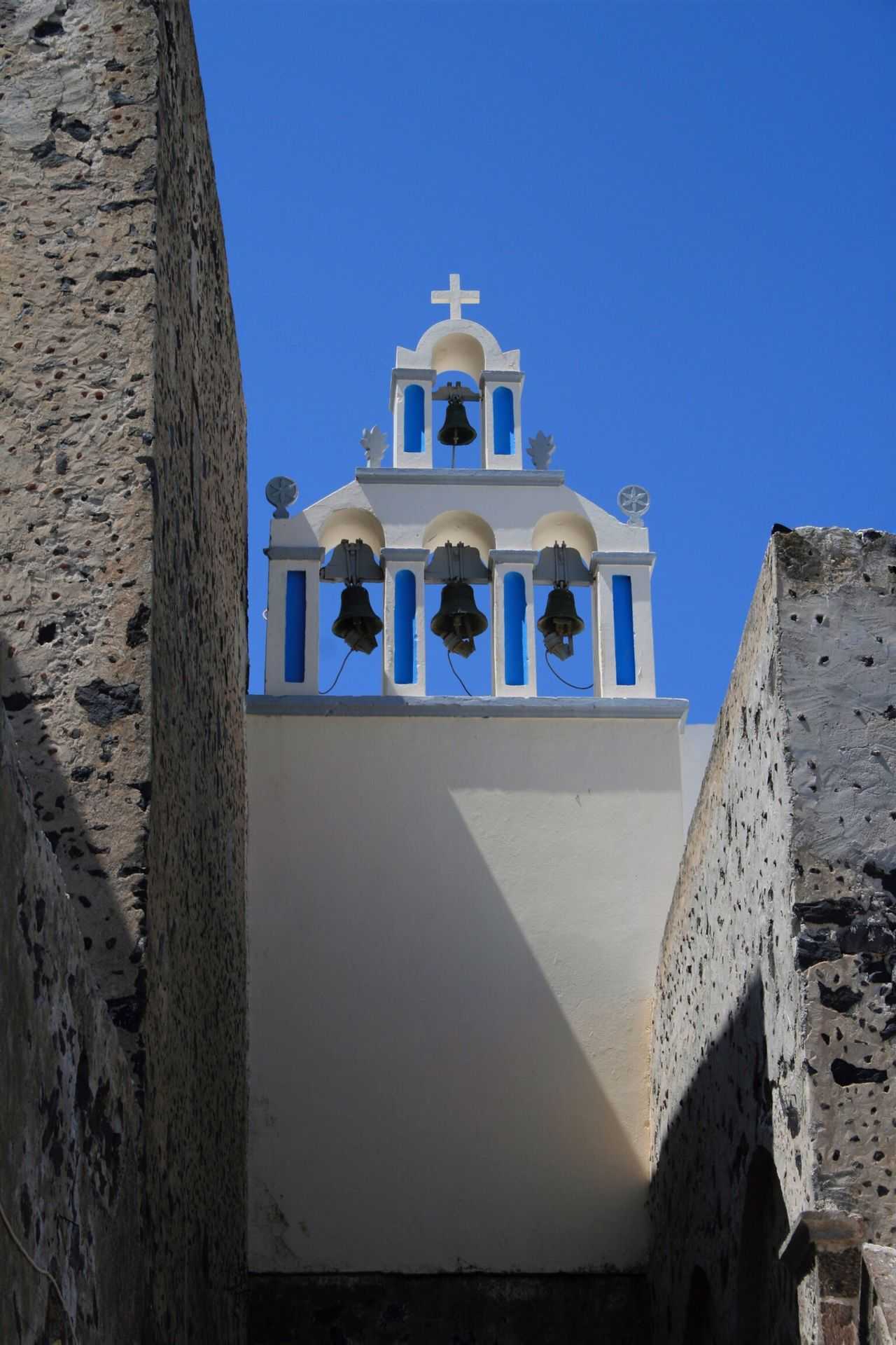 Churches of Santorini 🇬🇷 07 Religion Place Of Worship Architecture Built Structure Building Exterior Spirituality Blue Clear Sky Sunlight Outdoors Low Angle View Cross Travel Destinations Day No People Sky Whitewashed Dome Bell Bell Tower Santorini, Greece Vacations Canonphotography Canon400d Spirituality