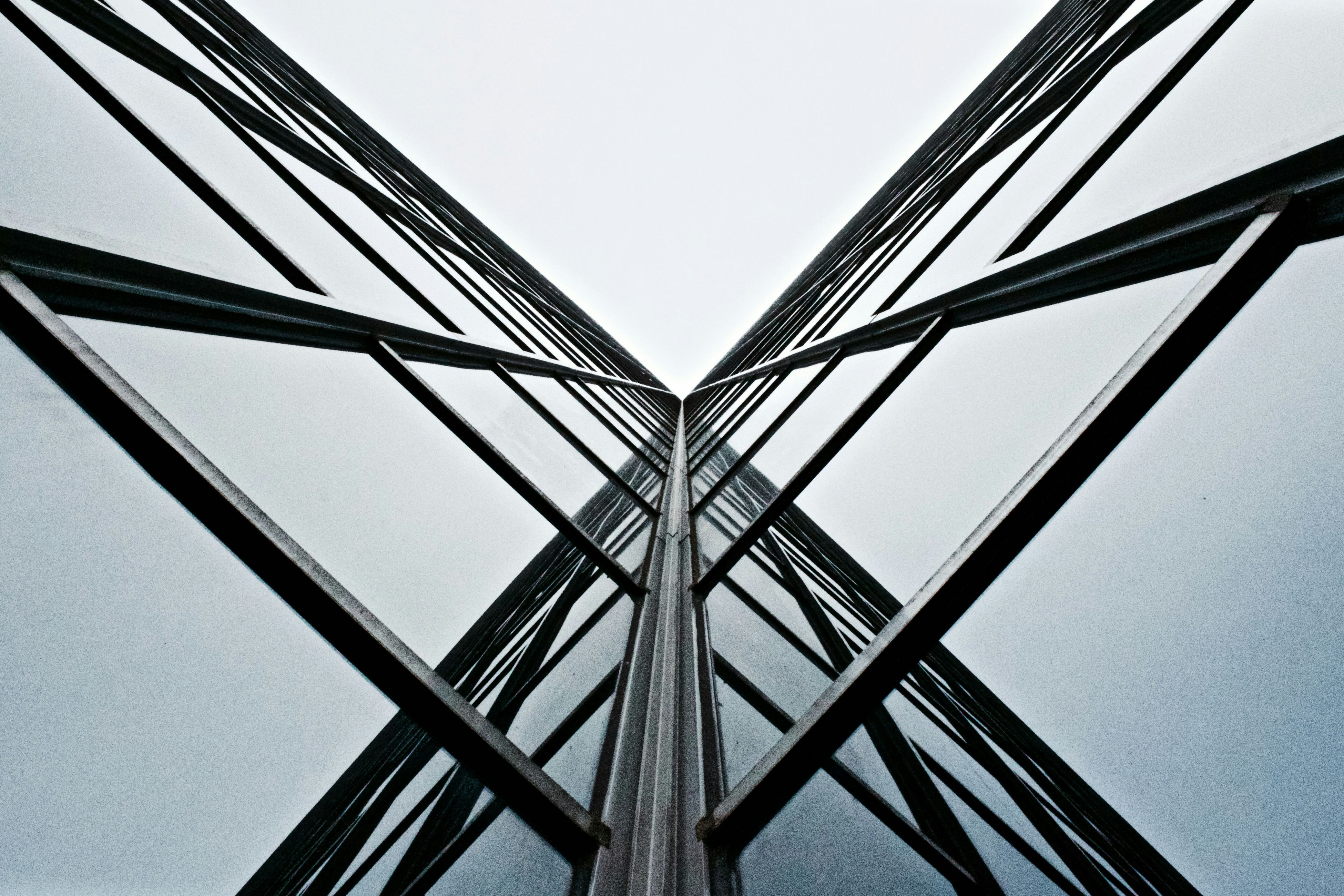 architecture, low angle view, built structure, building exterior, clear sky, modern, building, office building, tall - high, directly below, city, skyscraper, glass - material, tower, day, sky, outdoors, window, pattern, no people
